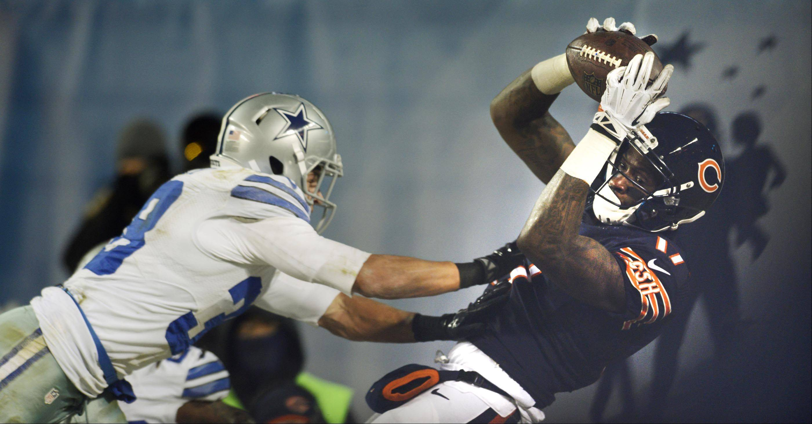 Chicago Bears wide receiver Alshon Jeffery keeps his feet inbounds as he hauls in a late first-half touchdown pass as Dallas Cowboys strong safety Jeff Heath covers.