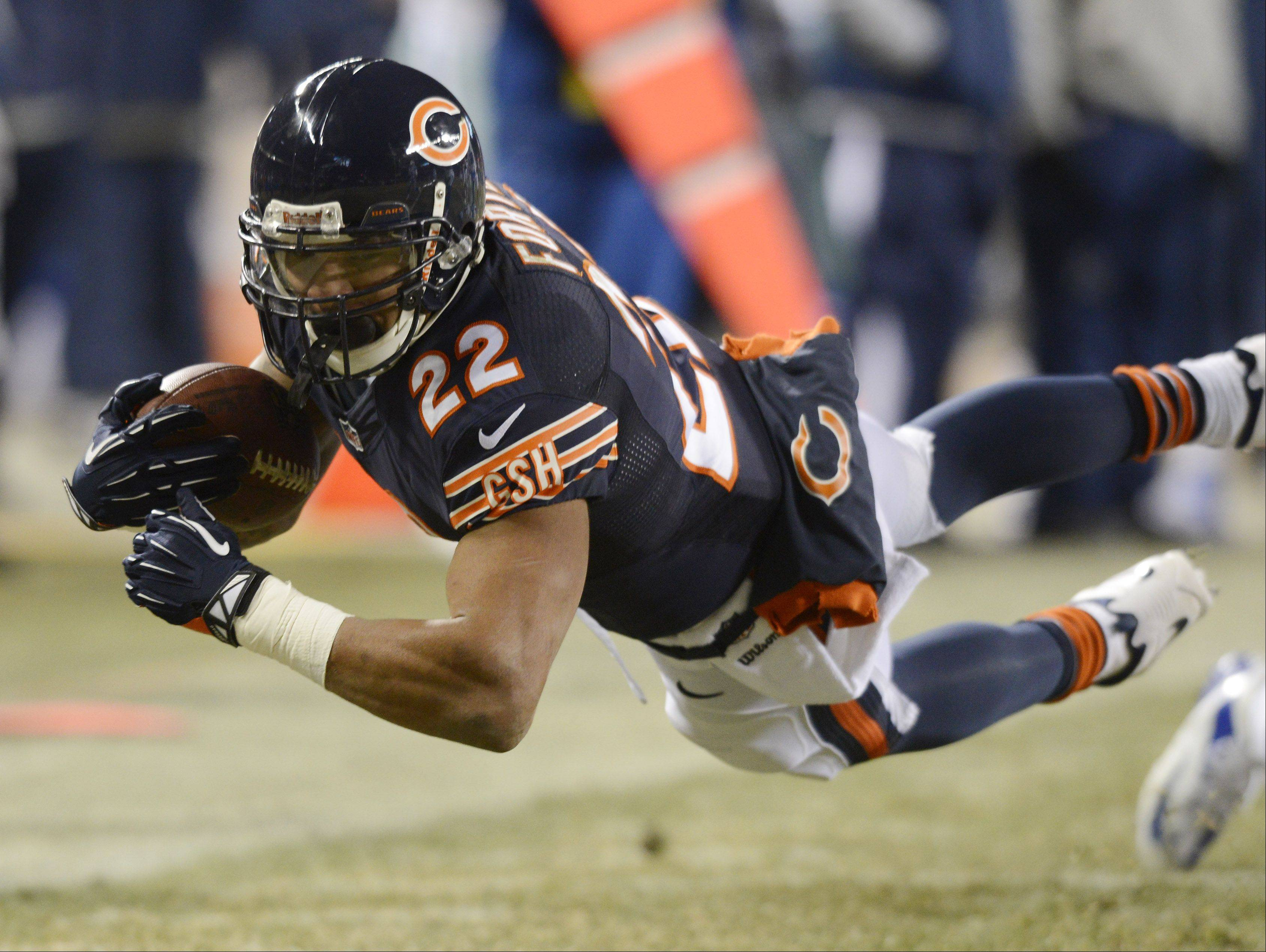 Chicago Bears running back Matt Forte dives for extra yardage against the Cowboys.