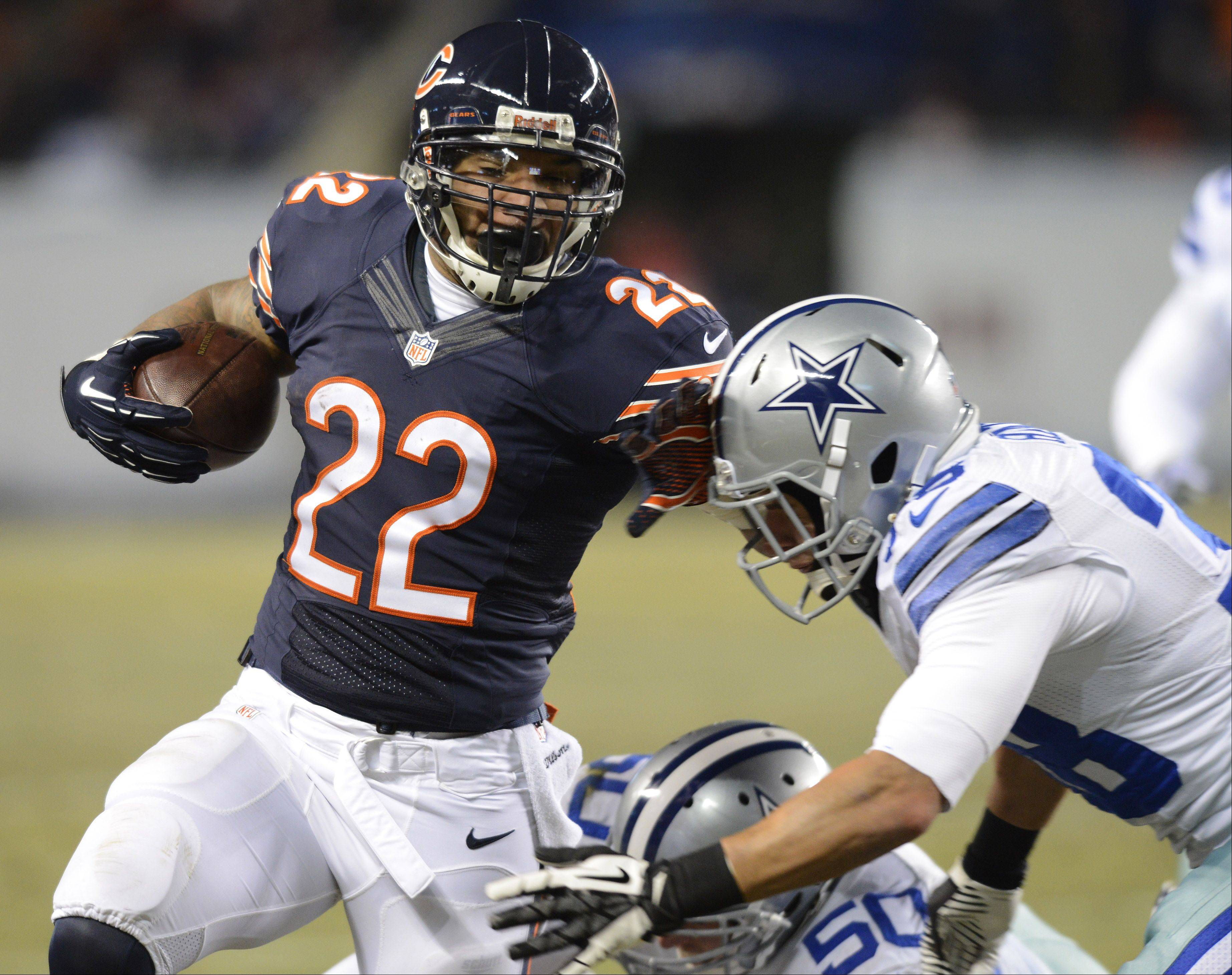 Chicago Bears running back Matt Forte carries the ball .