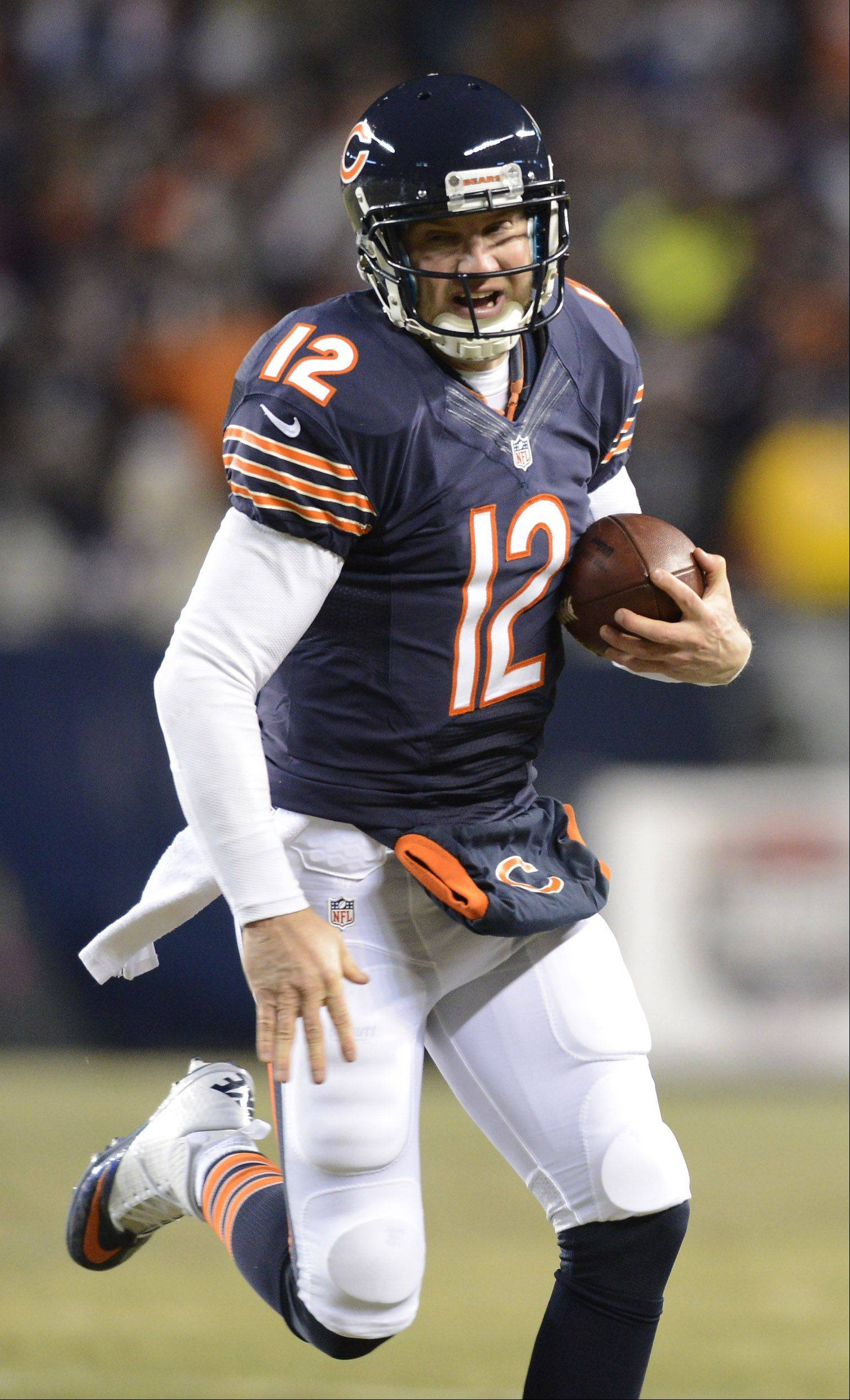 Chicago Bears quarterback Josh McCown carries the ball for a first down.