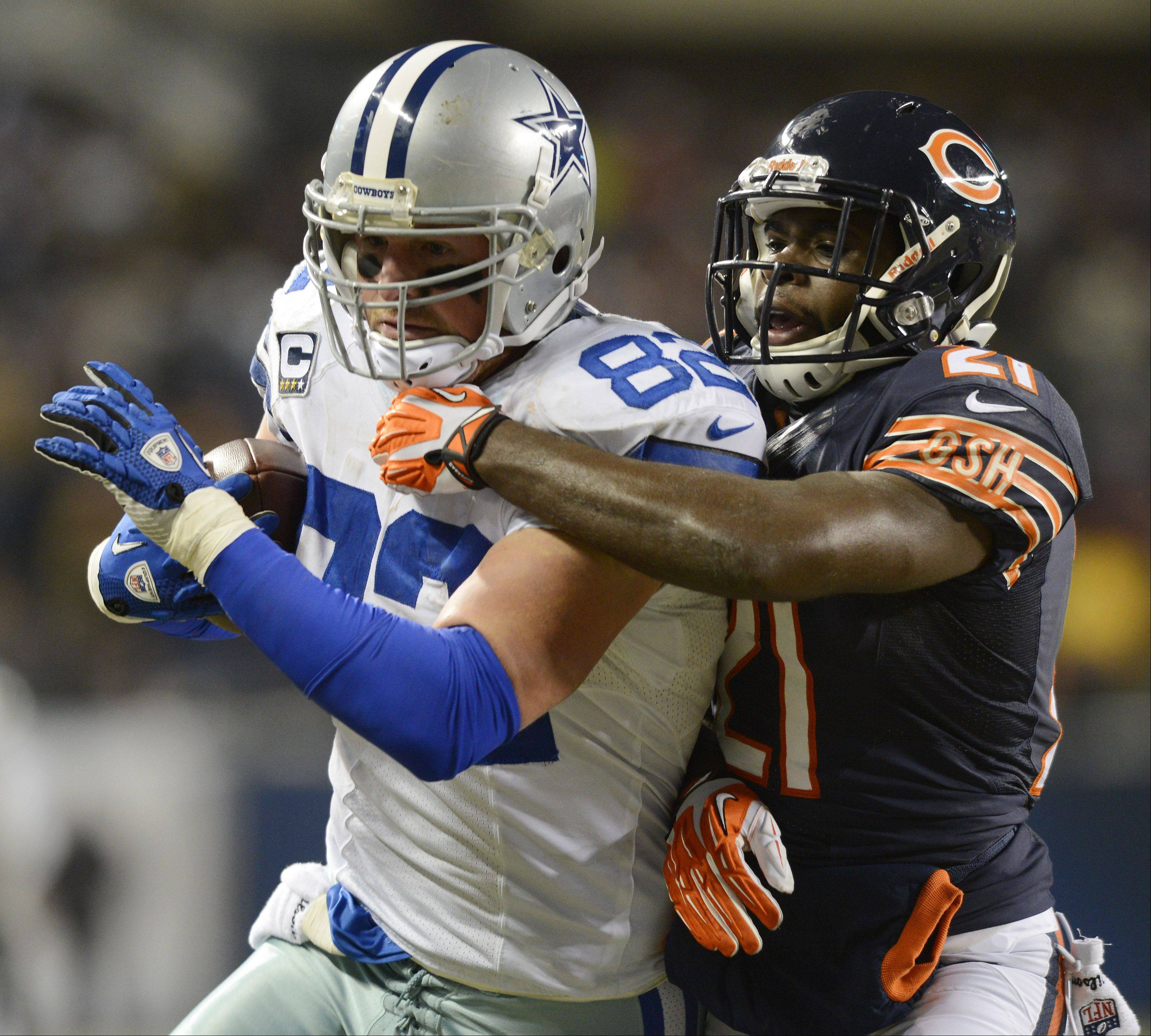 Chicago Bears strong safety Major Wright tries to hold back Dallas Cowboys tight end Jason Witten.