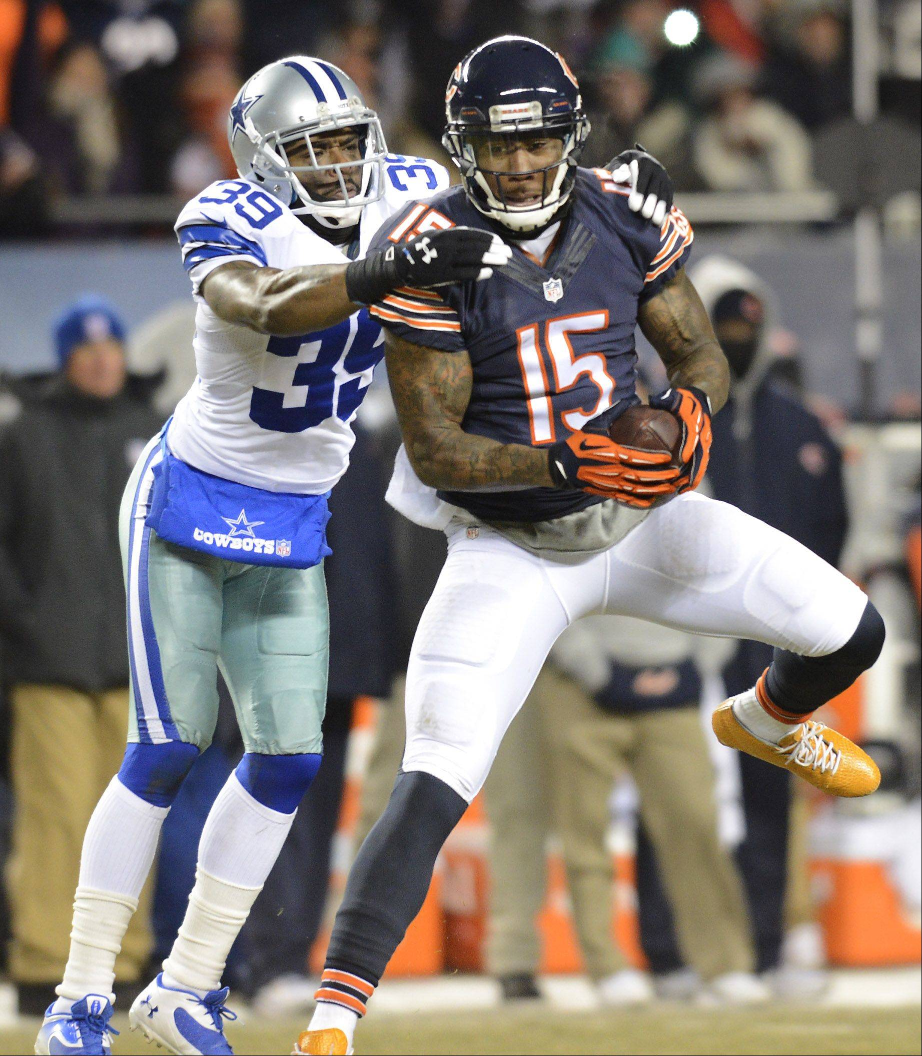 Chicago Bears wide receiver Brandon Marshall makes a catch in front of Dallas Cowboys cornerback Brandon Carr.