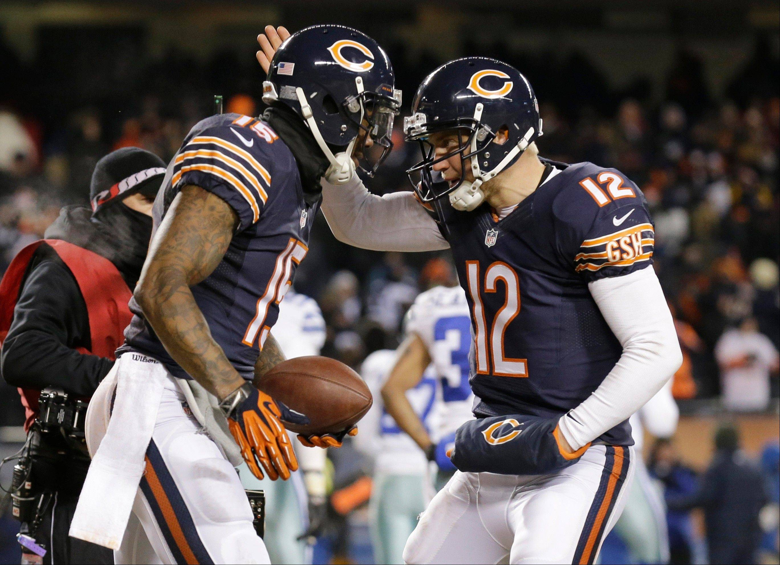 Chicago Bears wide receiver Brandon Marshall and quarterback Josh McCown celebrate after making a two-point conversion.