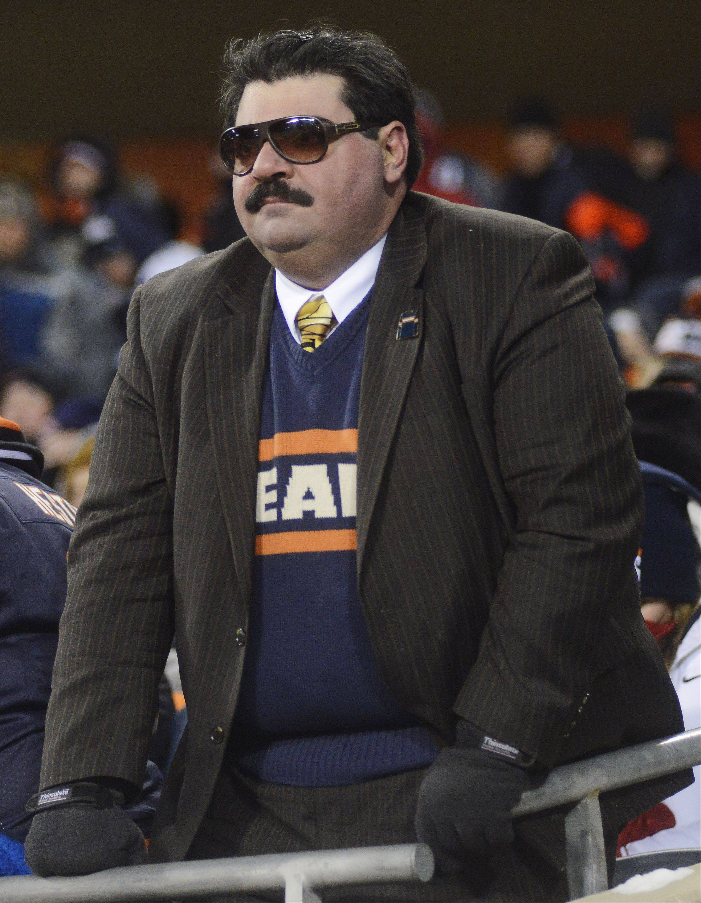 A Mike Ditka fan watches the Bears during Monday's game at Soldier Field.