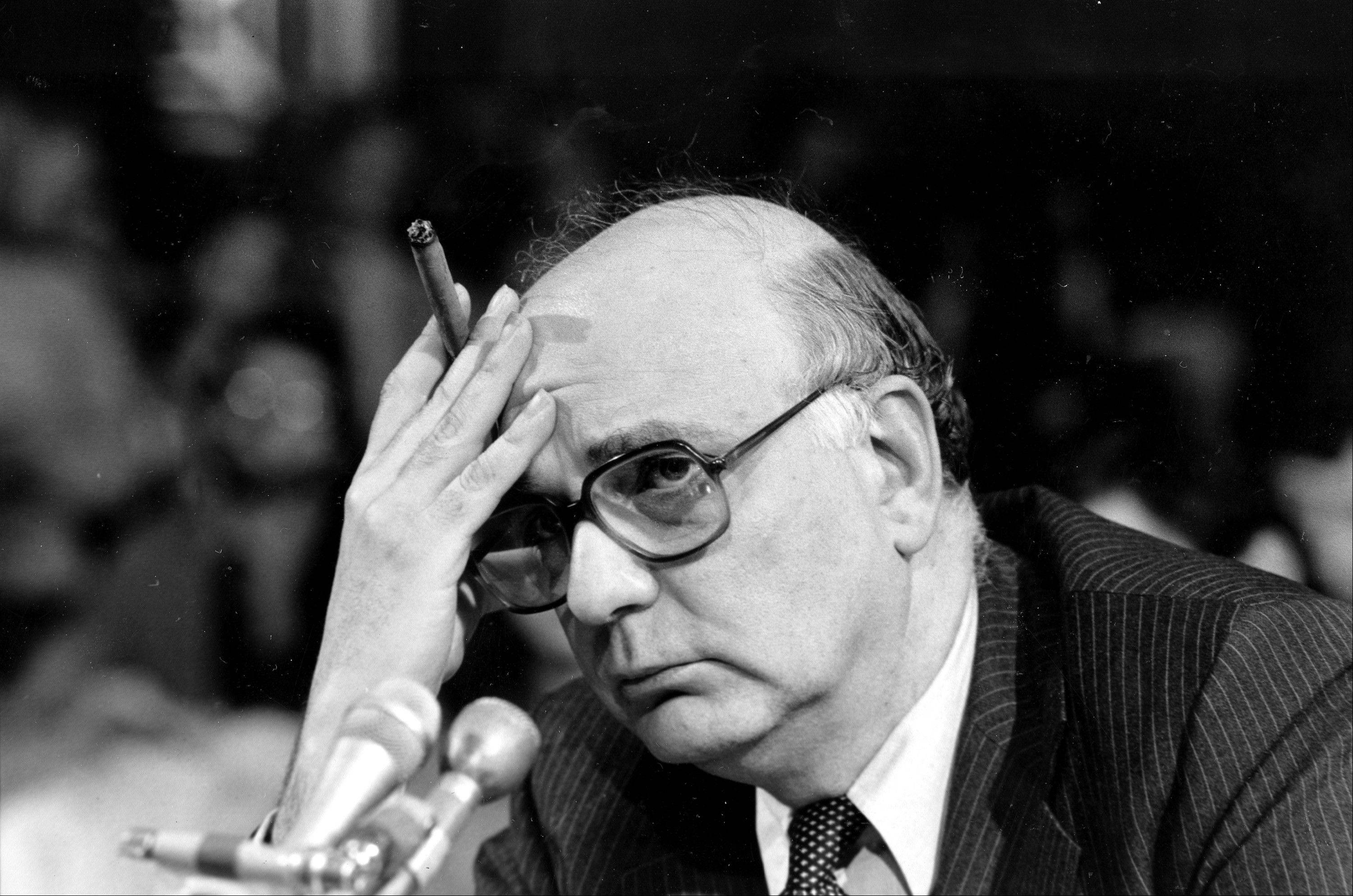In this 1980 photo, Federal Reserve Board Chairman Paul Volcker listens to a question as he appears before the Senate Banking Committee. The Federal Reserve and the Federal Deposit Insurance Corp. each unanimously voted to adopt the so-called Volcker Rule, taking a major step toward preventing extreme risk-taking on Wall Street that helped trigger the 2008 financial crisis.