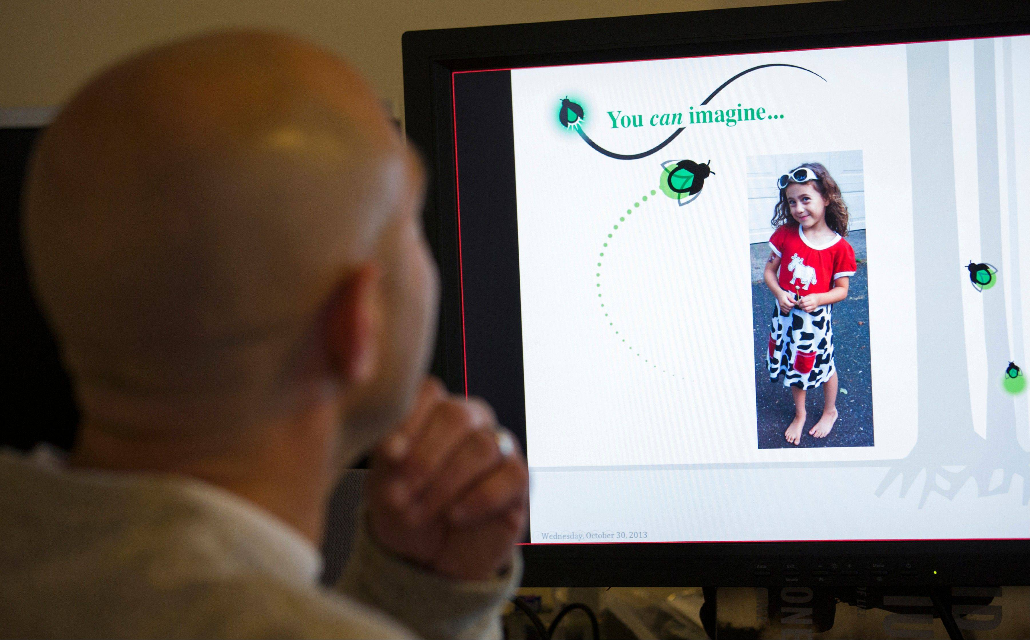 Jeremy Richman looks at a picture of his daughter, Avielle Richman, on his computer screen as he gives a lecture via Skype on behalf of the Avielle Foundation from his Newtown, Conn. home. Avielle was one of 20 Sandy Hook Elementary School students that were killed in a mass shooting Dec. 14, 2012.