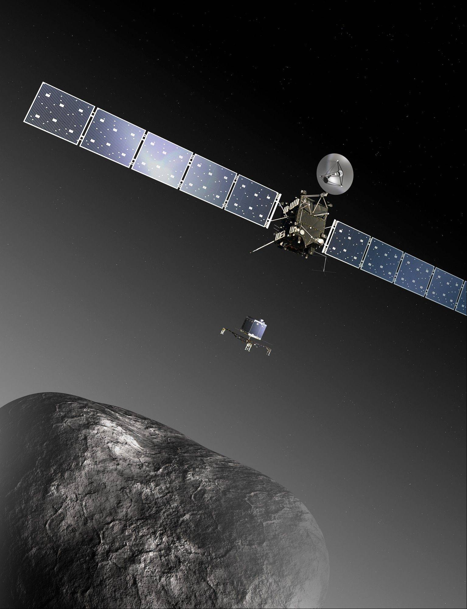 Though not to scale, this is an artist's impression of the Rosetta orbiter deploying the Philae lander to comet 67P/ChuryumovñGerasimenko. The European Space Agency has set a tentative date for the first landing of a spacecraft on a comet: next Nov. 11.