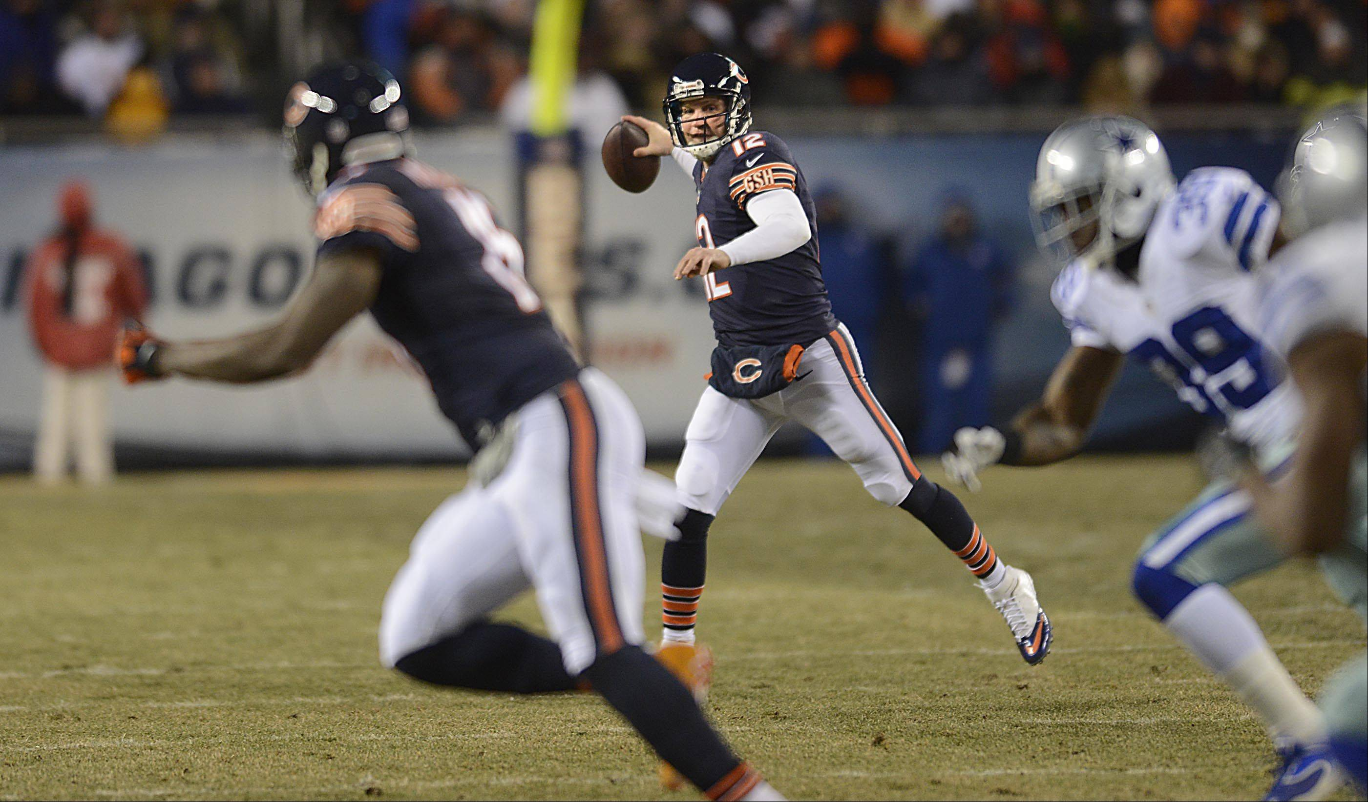 Bears quarterback Josh McCown targets wide receiver Brandon Marshall on Monday night on his way to 348 yards passing. It was McCown's third straight 300-plus game, the first time that has happened in franchise history.