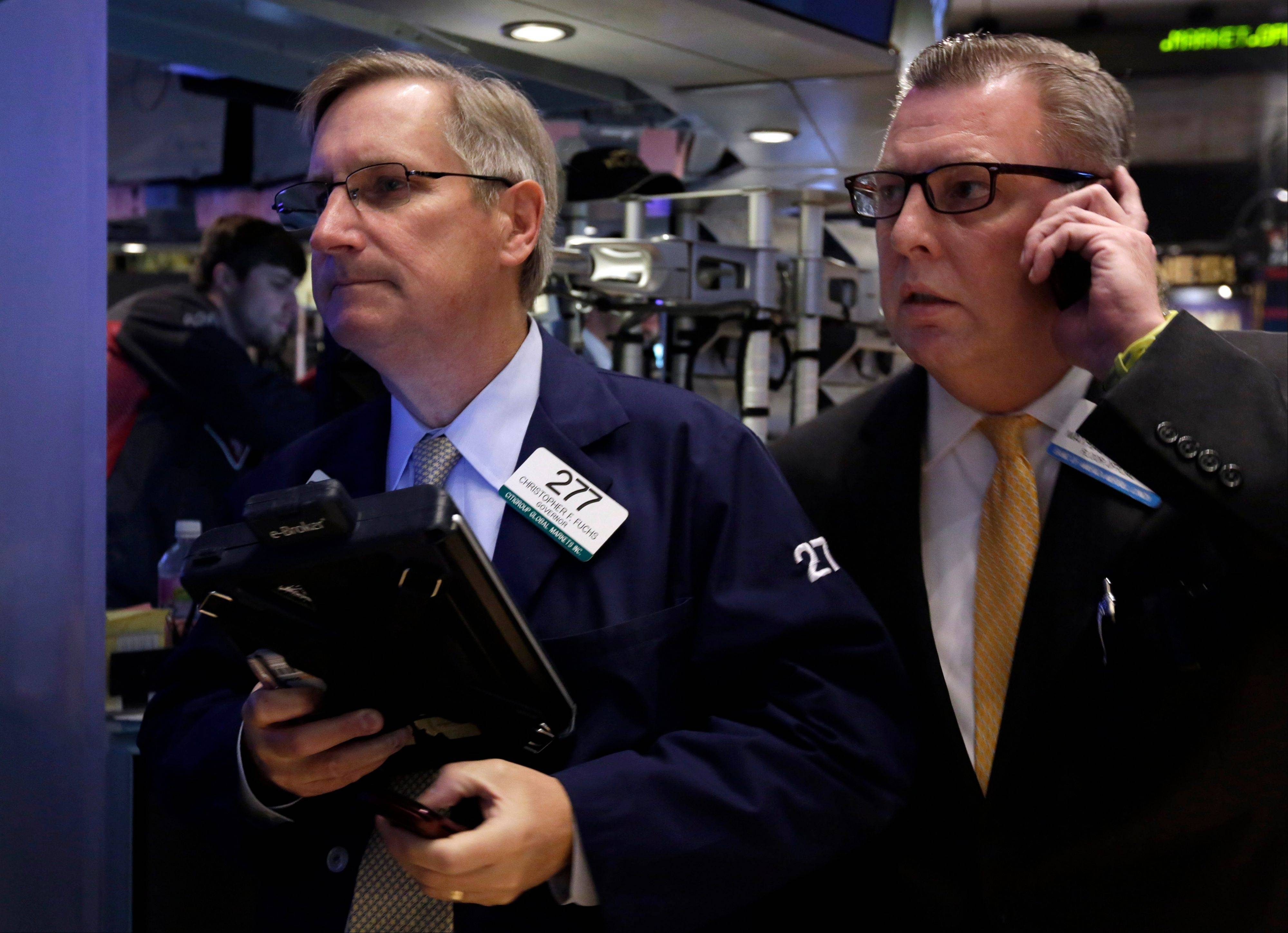 U.S. stocks fell Tuesday, after the Standard & Poor's 500 Index reached a record, as investors weighed federal budget negotiations and better-than-estimated economic data to gauge the timing of any Federal Reserve stimulus cuts.