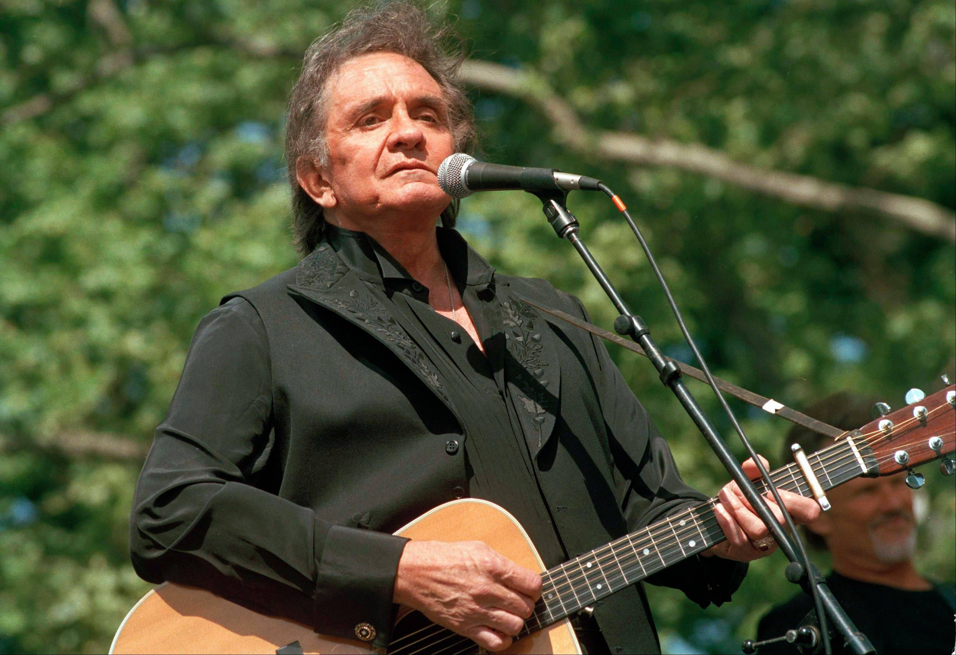 "Johnny Cash, here performing at a 1993 benefit concert in Central Park in New York, can be heard once again on the new album, ""Out Among the Stars,"" comprised of 12 studio recordings that were recently discovered."