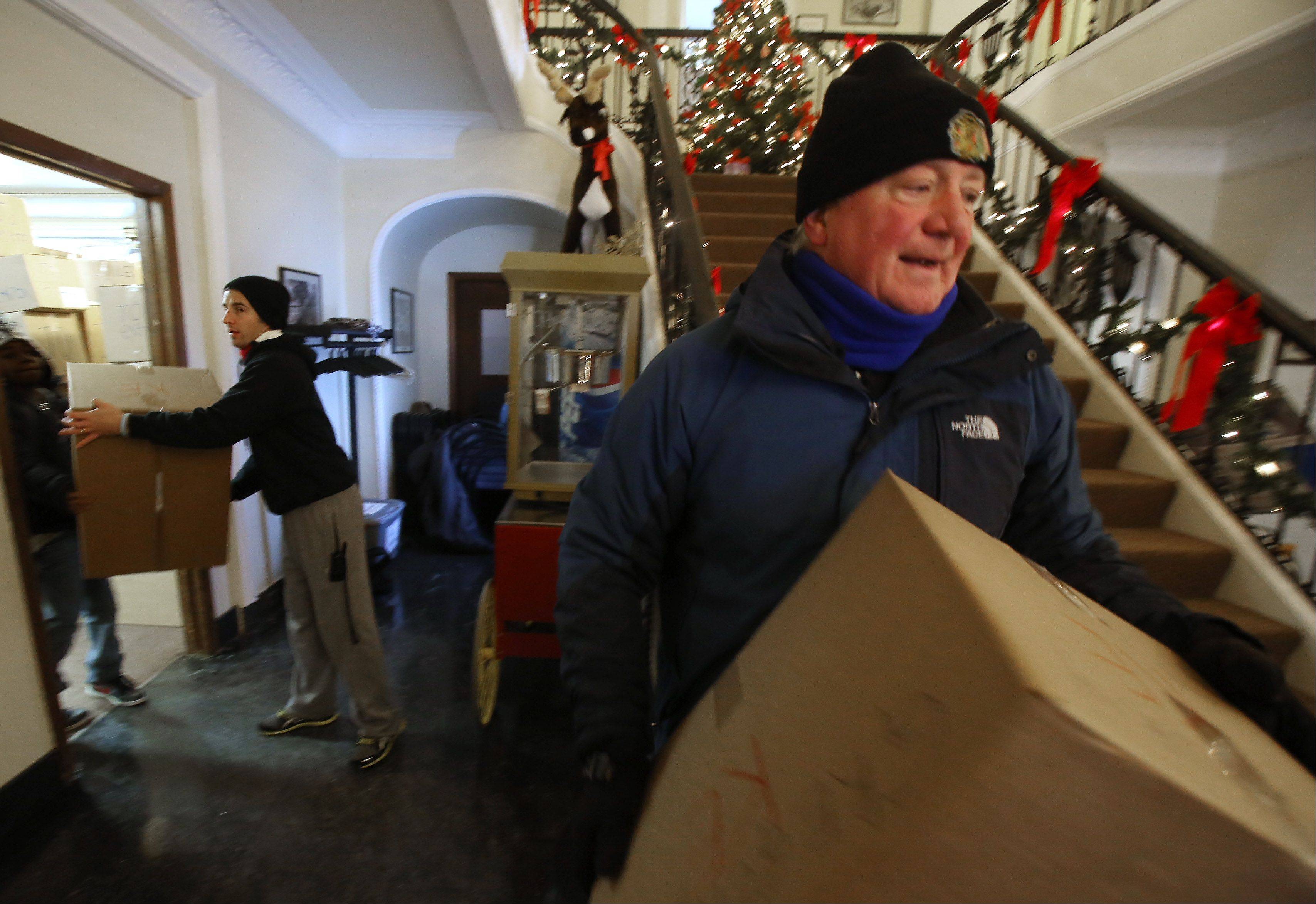 Volunteers Rich Heneberry of Lake Villa, right, and Matt Bohmann of Lindenhurst load boxes of gifts on trucks Tuesday at One Hope United in Lake Villa. The annual drive gathered nearly 2,700 gifts for children in need.