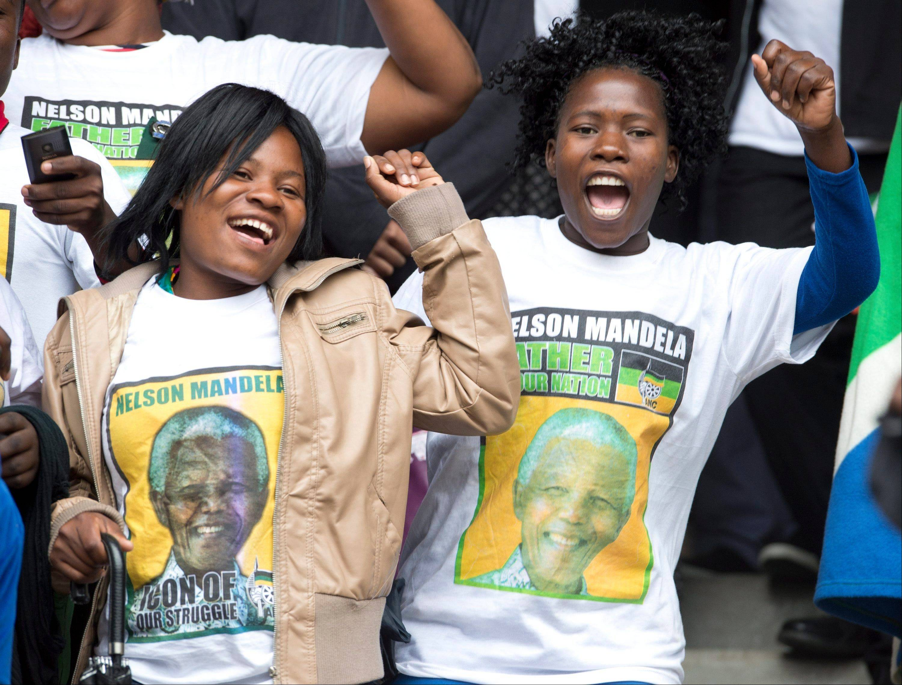 Women sing in the audience during the memorial service for Nelson Mandela Tuesday Dec. 10, 2013 in Johannesburg, South Africa.
