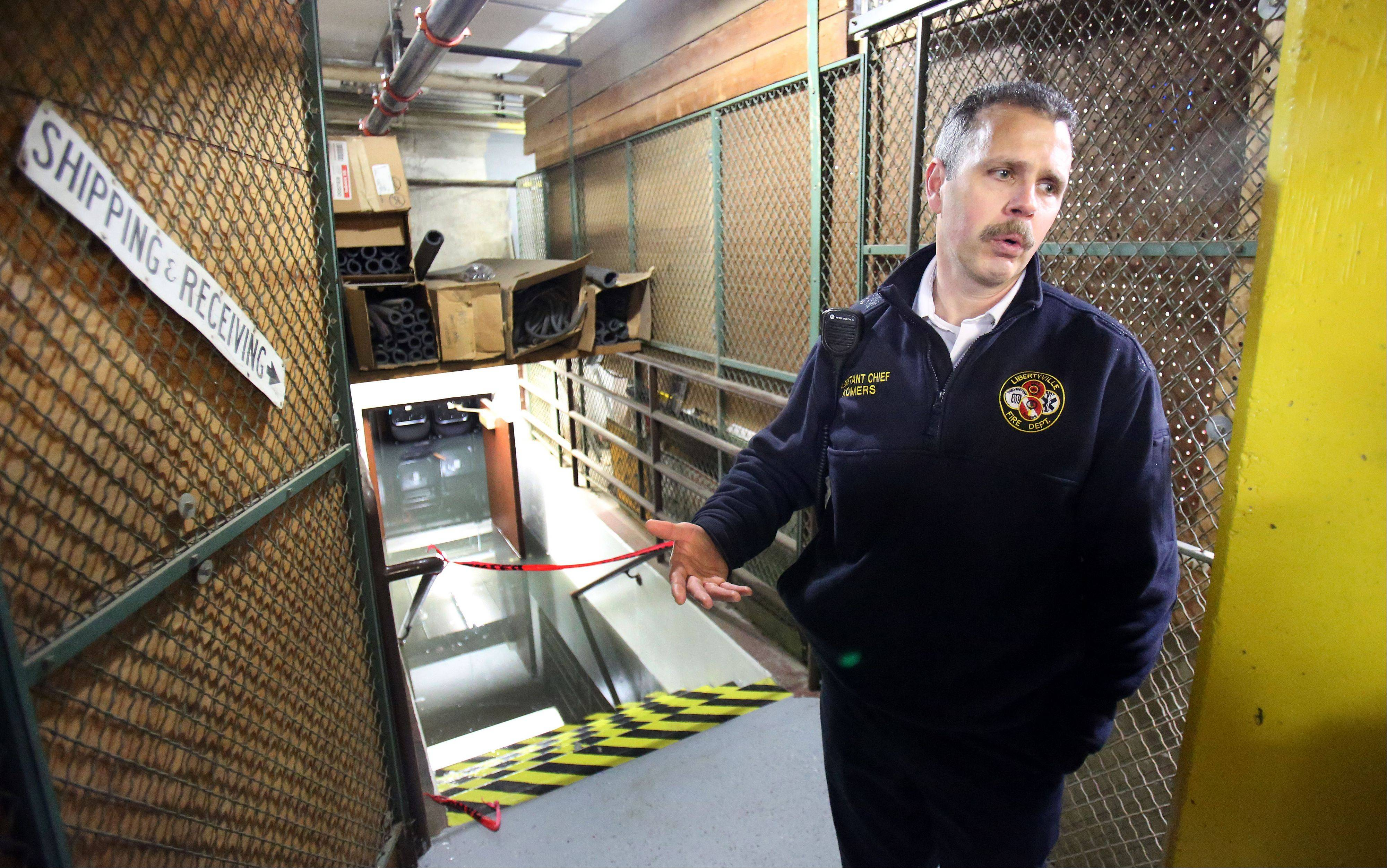 An April rainstorm flooded a subbasement at Libertyville High School. Here, Assistant Fire Chief Ken Komers surveys the damage.