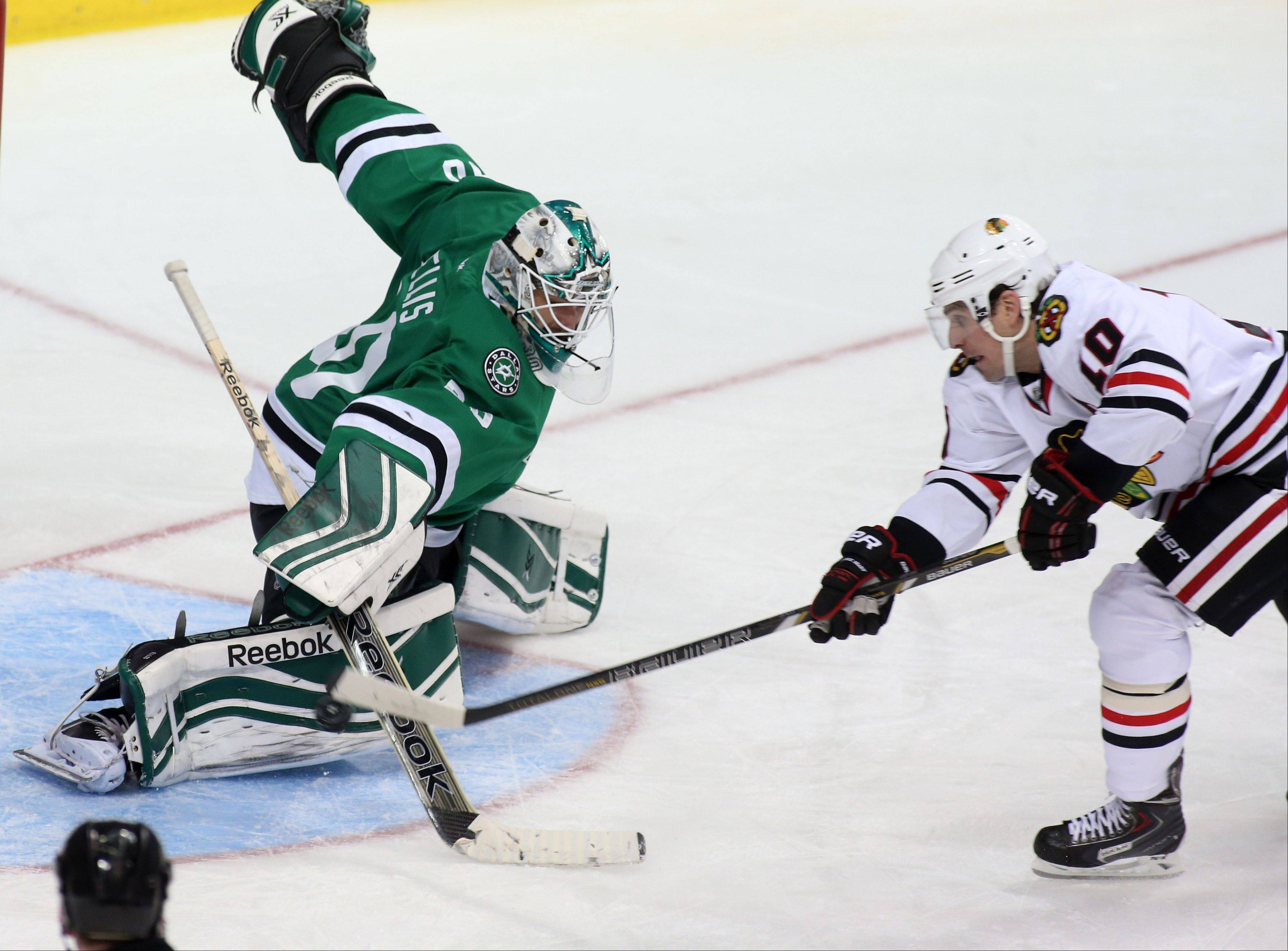 Dallas Stars goalie Dan Ellis (30) gives up a goal to Chicago Blackhawks left wing Patrick Sharp (10) Tuesday night in Dallas. The Blackhawks defeated the Stars 6-2.