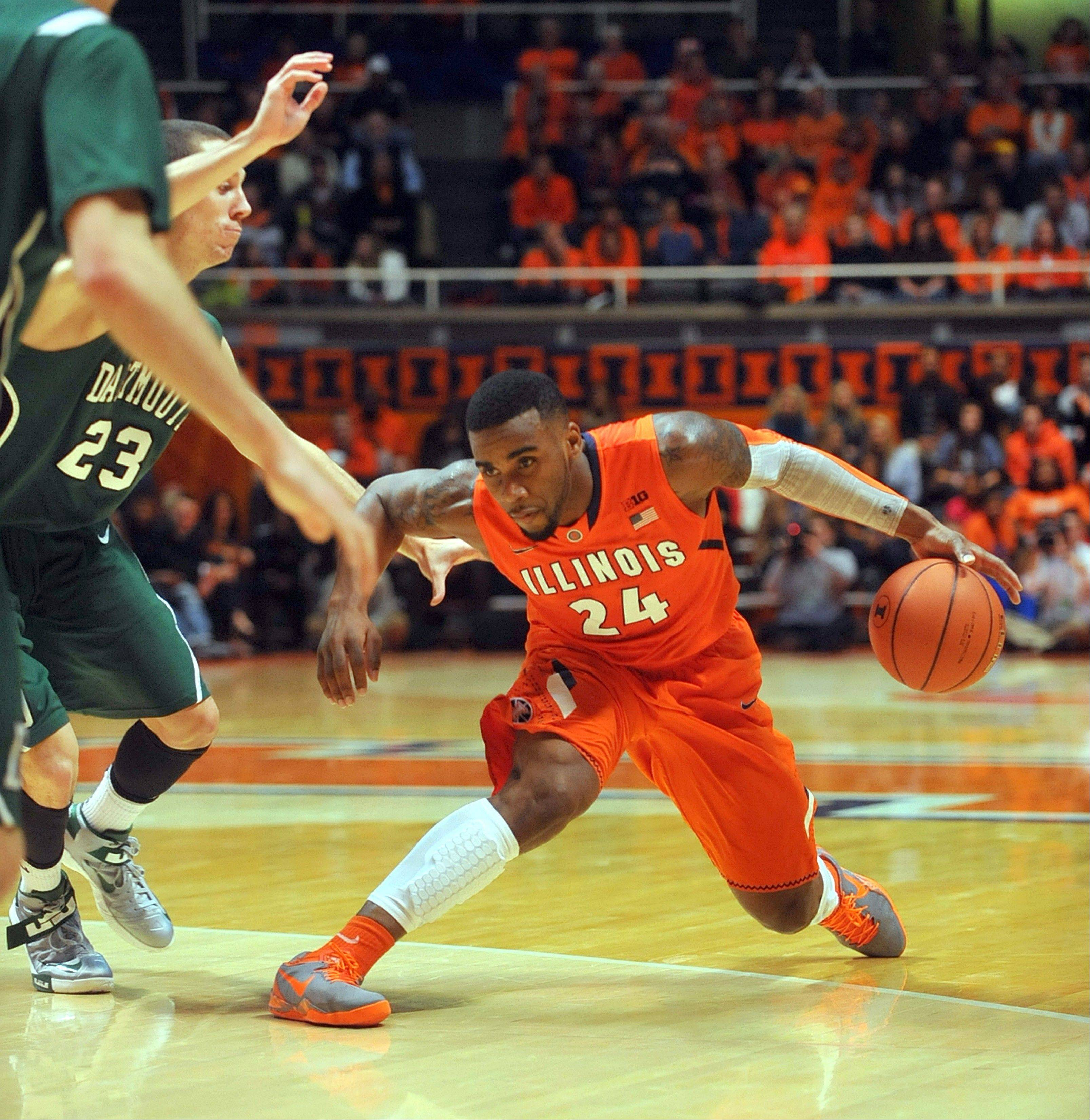Illinois guard Rayvonte Rice (24) stops his drive defended by Dartmouth Big Green forward John Golden (23) during Tuesday night's game in Champaign. The Illini beat Dartmouth 72-65.