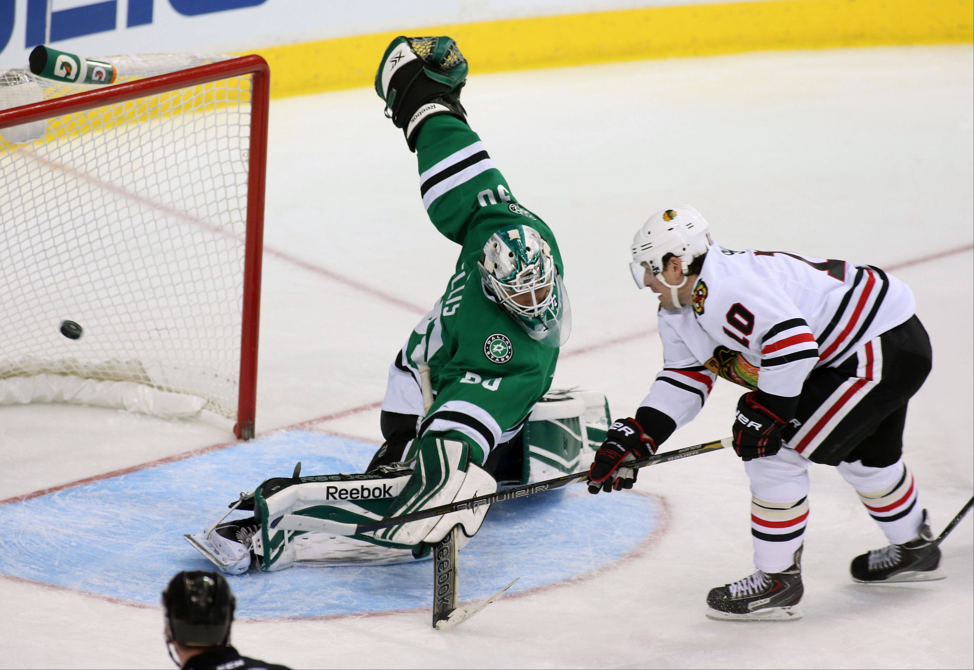 Patrick Sharp scores on Stars goalie Dan Ellis for 1 of his 2 goals in the second period Tuesday night.