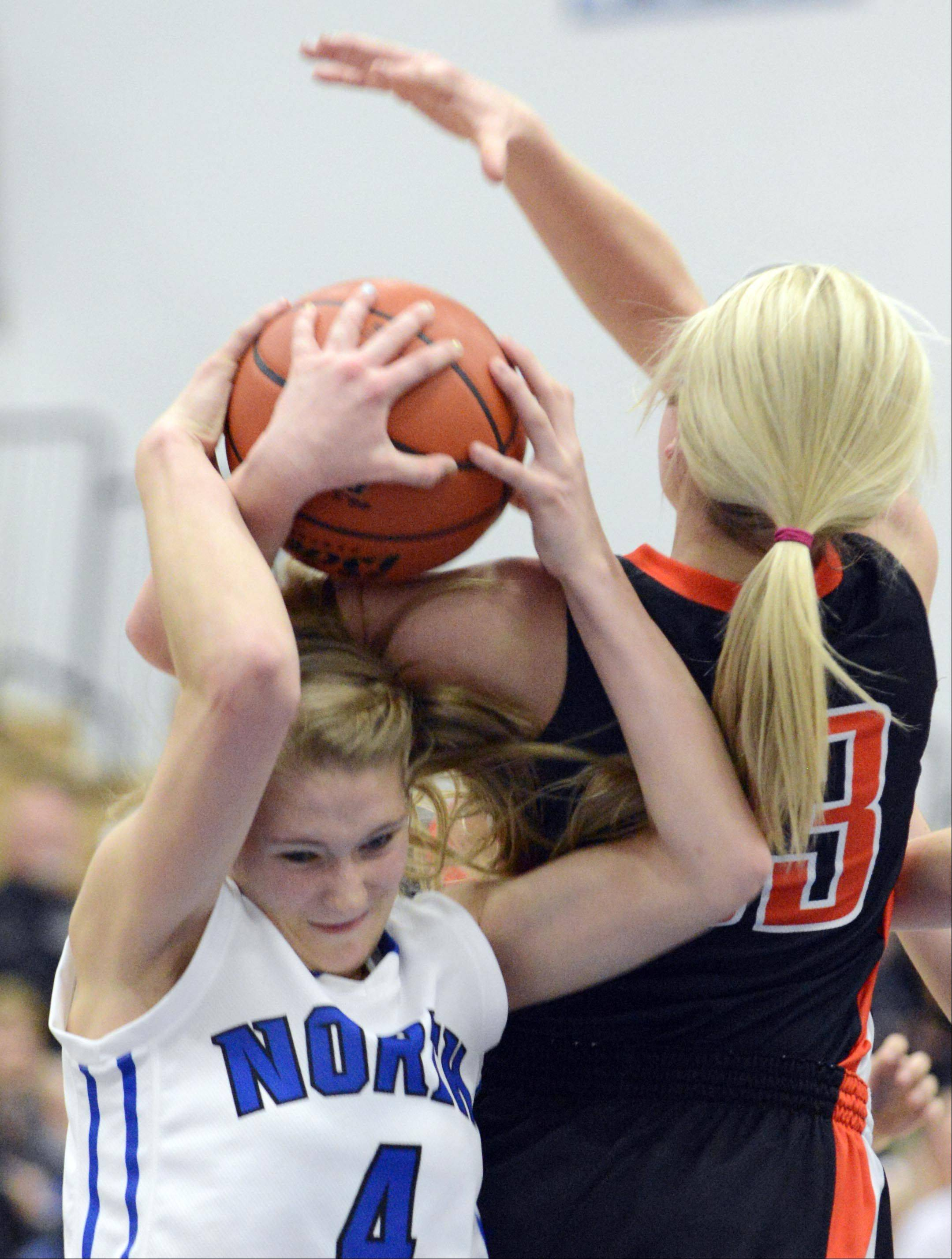 St. Charles North's Morgan Rosencrants tangles with St. Charles East's Hannah Nowling Saturday.