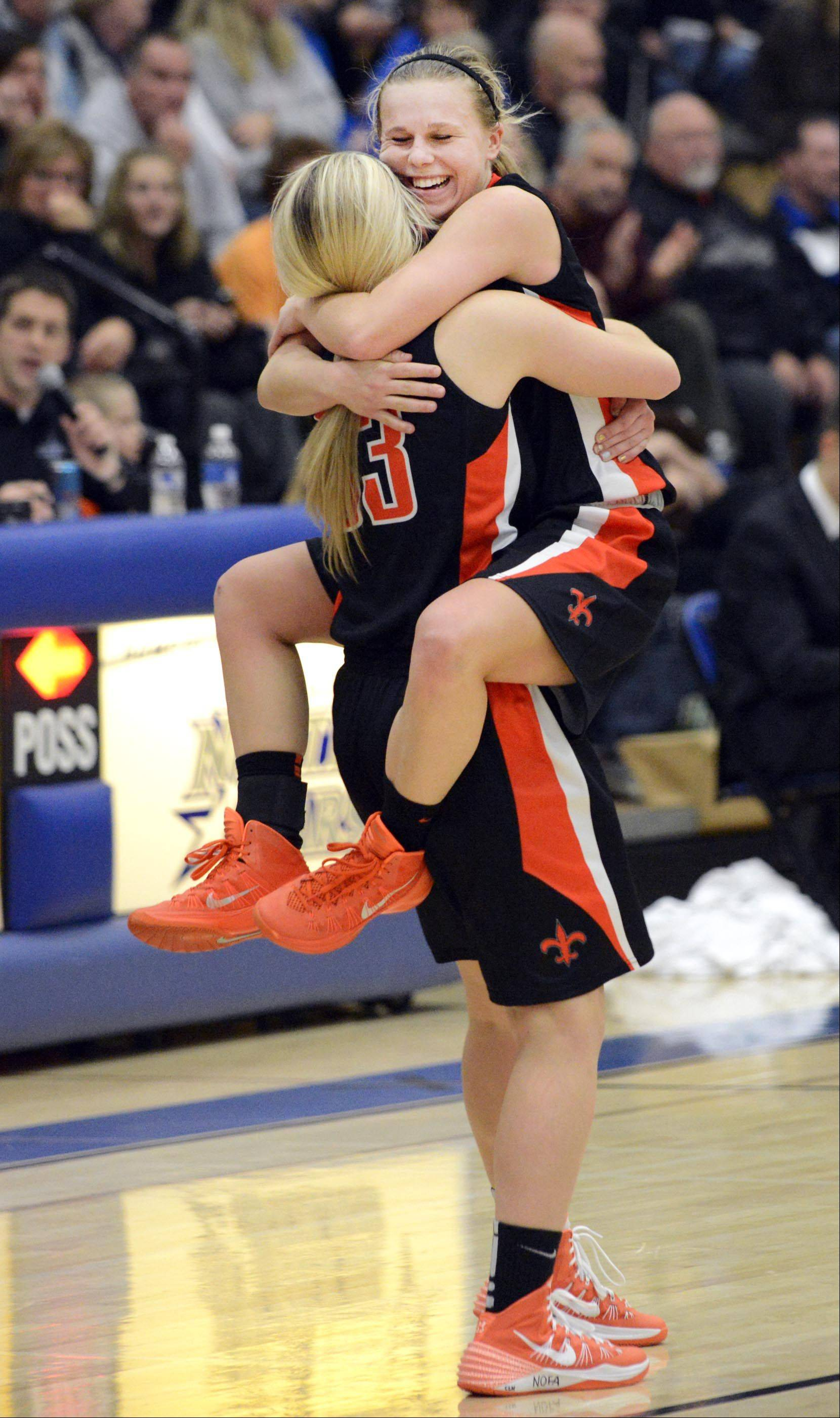 St. Charles East's Amanda Hilton celebrates with teammate Hannah Nowling after defeating St. Charles North Saturday.