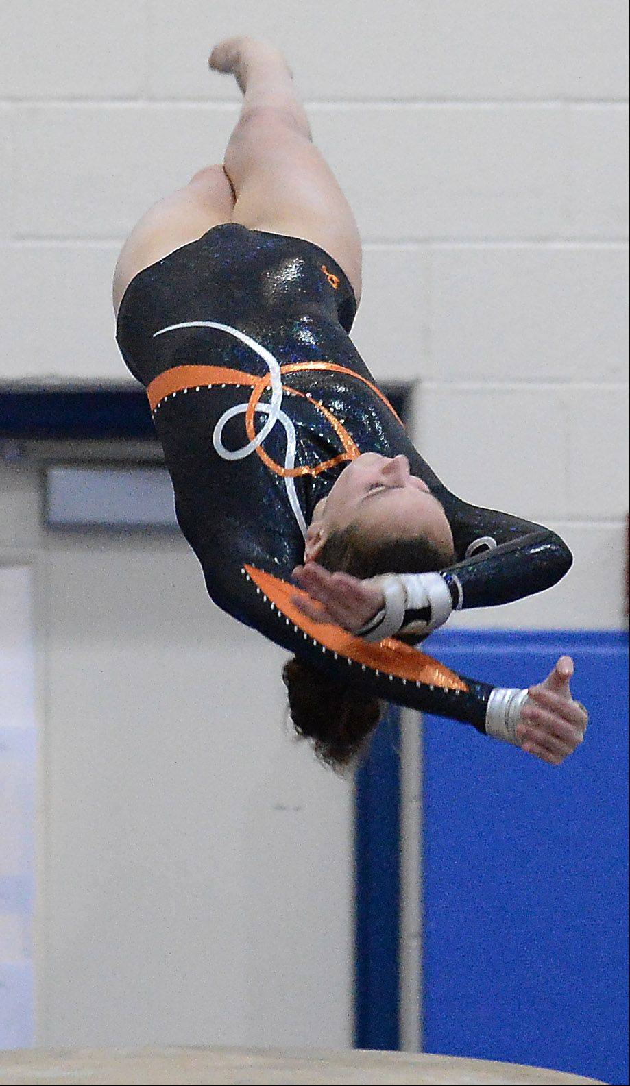 Hersey's Maggie Barton flys off the vault during Wednesday's gymnastics meet in Hoffman Estates.