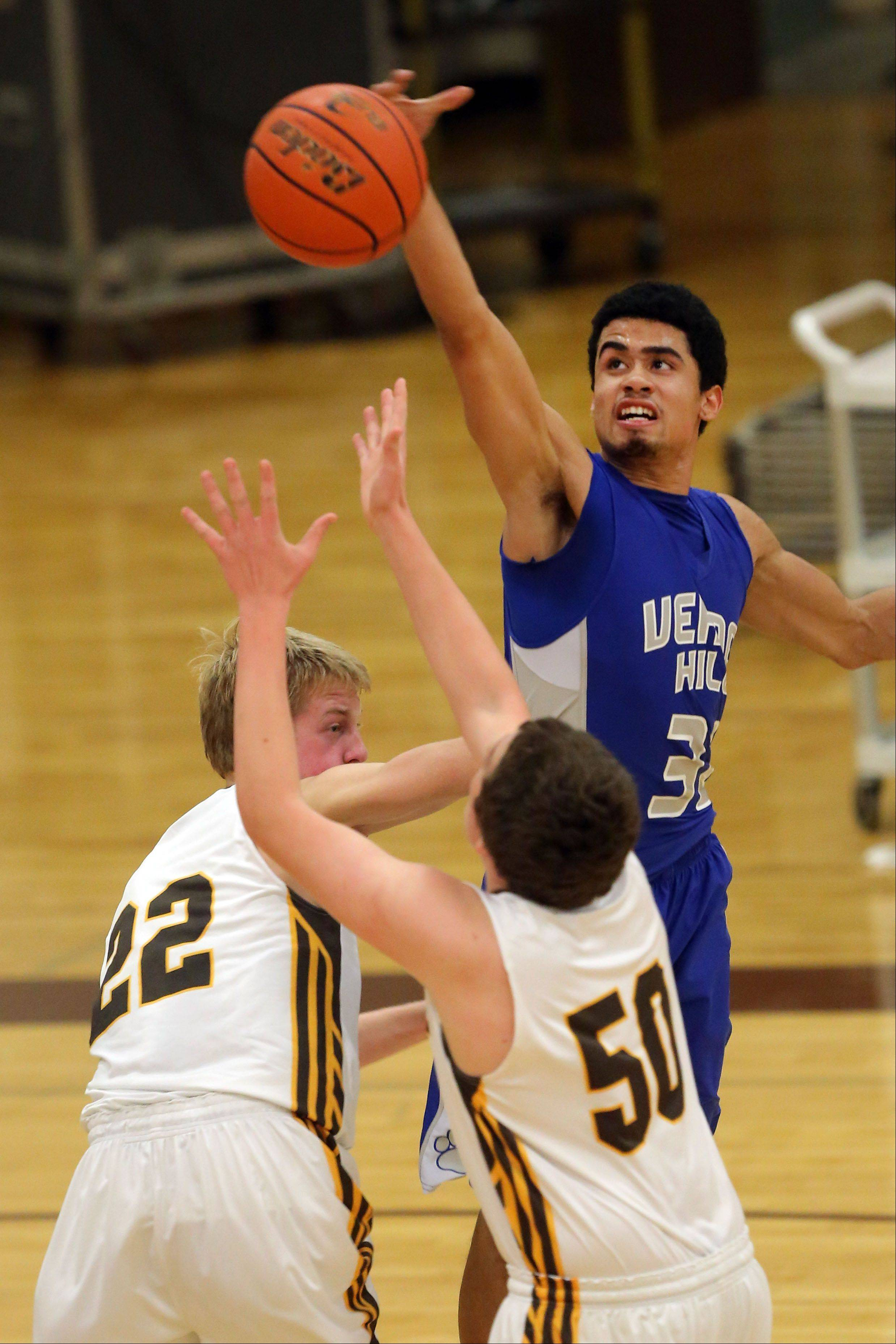 Vernon Hills' Lem Turner, right, blocks the shot of Carmel's Lee Bowen during Wednesday's game in Mundelein.