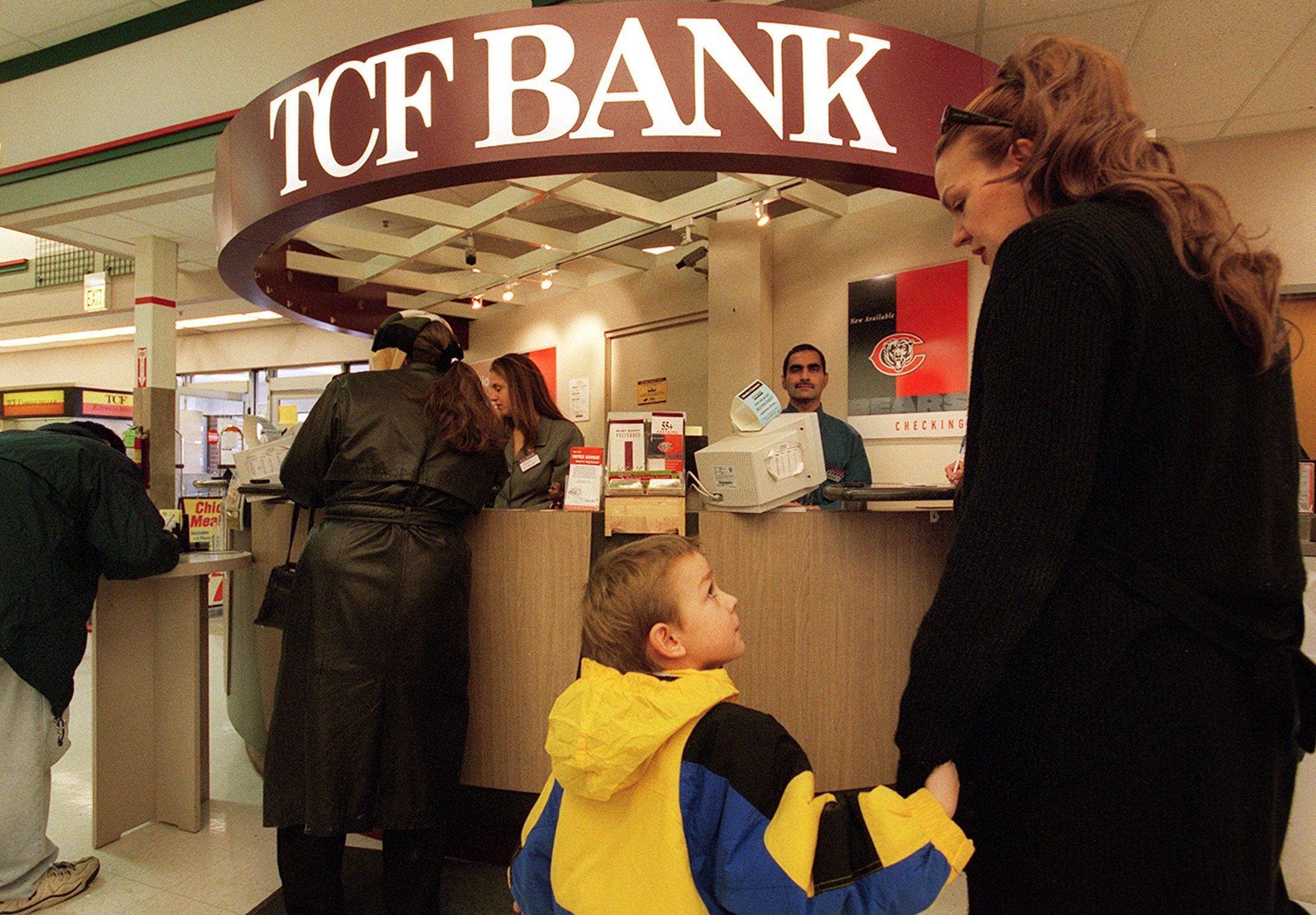 Customers wait their turn at the TCF Bank inside a Jewel-Osco in Arlington Heights.