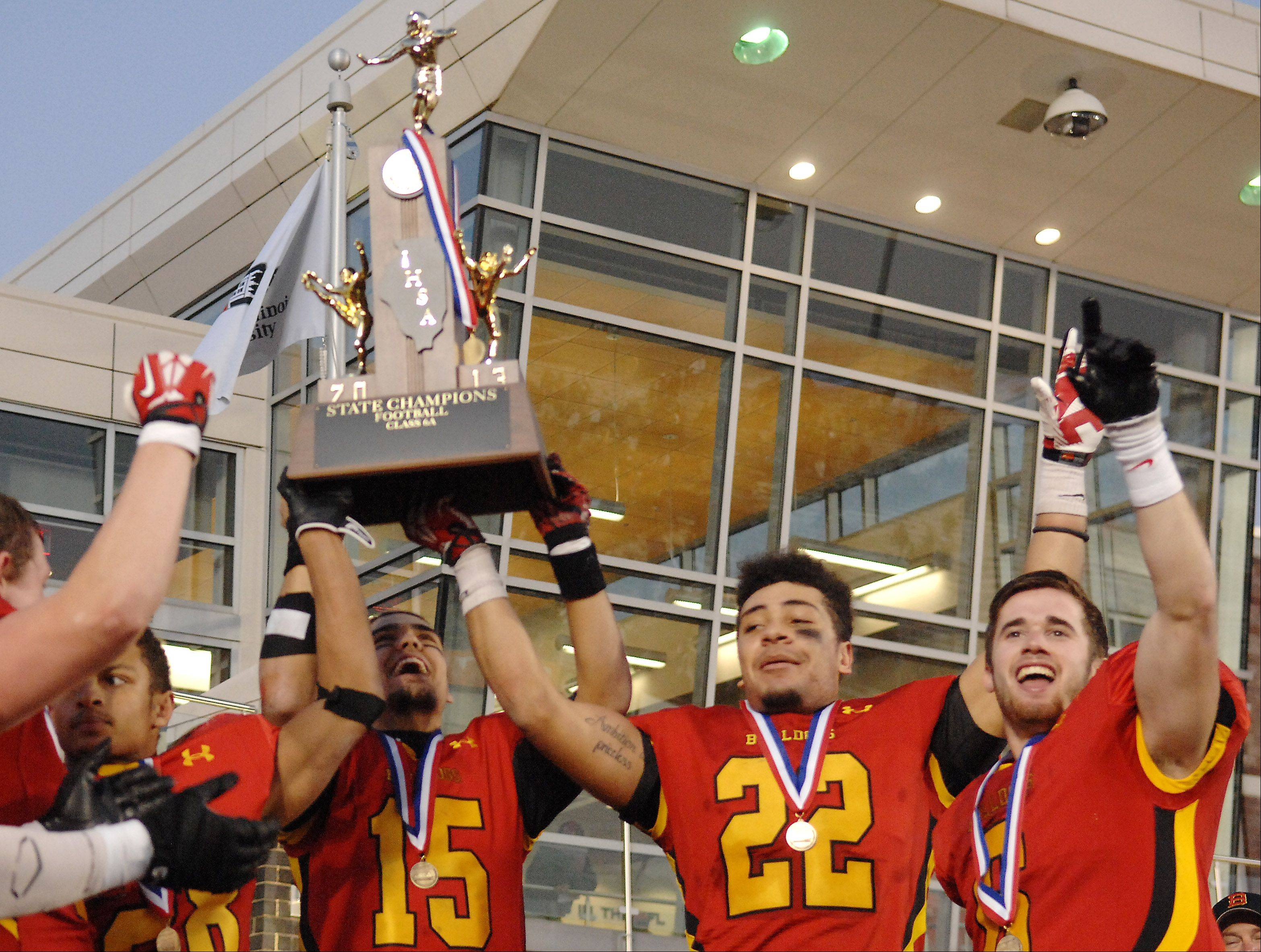 The Batavia captains hoist the championship trophy following their Class 6A championship game in DeKalb.