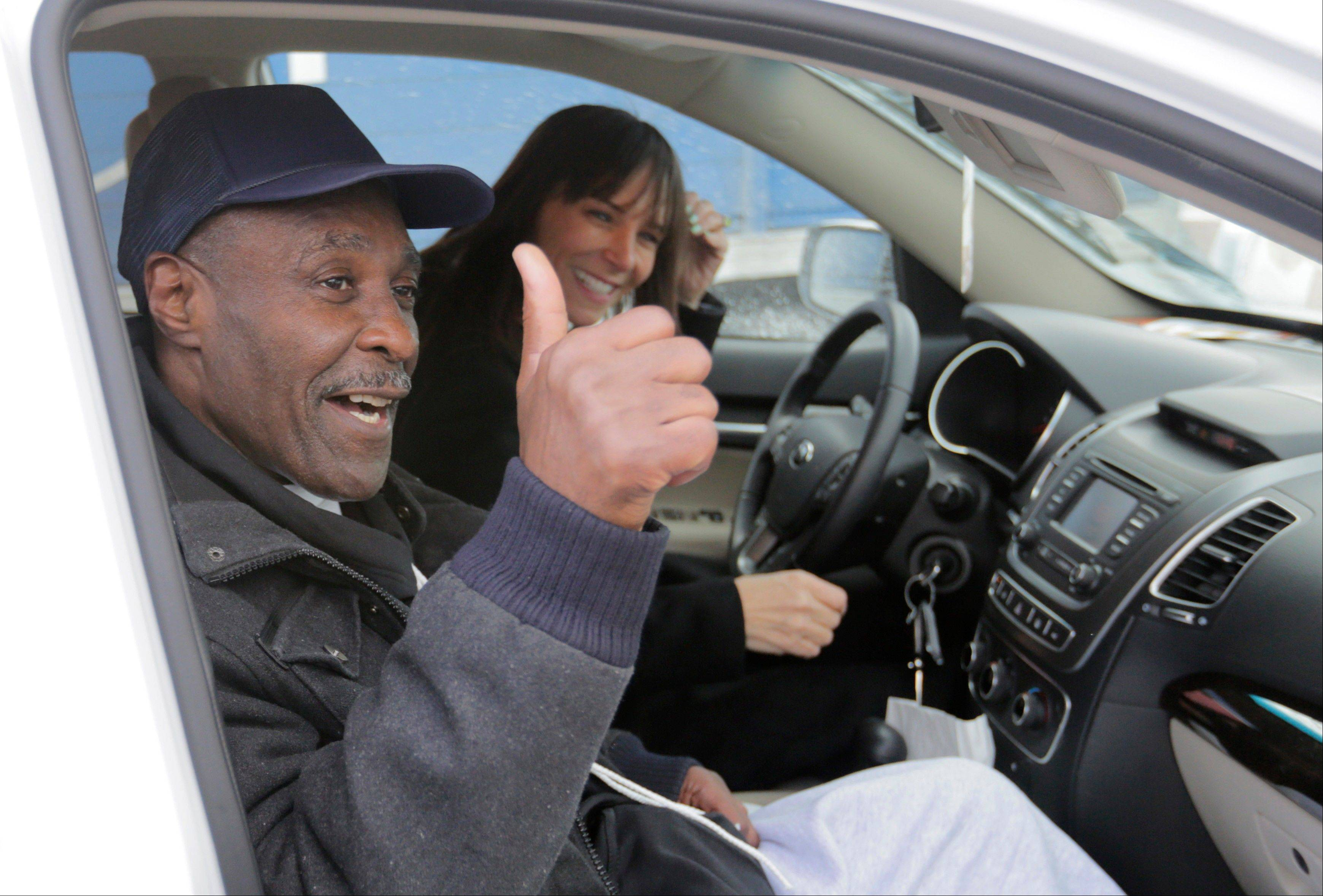 Stanley Wrice, left, convicted of rape and sentenced to 100 years in prison in 1982 gives a thumbs-up sign as he and his attorney Jennifer Bonjean, leave Pontiac Correctional Center Wednesday, Dec. 11, 2013 in Pontiac, Ill. Wrice was released after serving more than 30 years in prison when a Cook County Judge overturned his conviction the day before and granted him a new trial. Wrice has claimed for decades he was beaten and coerced into confessing to the rape by Chicago police Area 2 detectives working for disgraced former Chicago police Lt. Jon Burge. Burge himself, is now in federal prison after being convicted of perjury related to torture allegations.�Judge Richard Walsh's ruling comes after the officers working for Lt. Burge who Wrice says beat him, invoked their right not to testify. (AP Photos/M. Spencer Green)