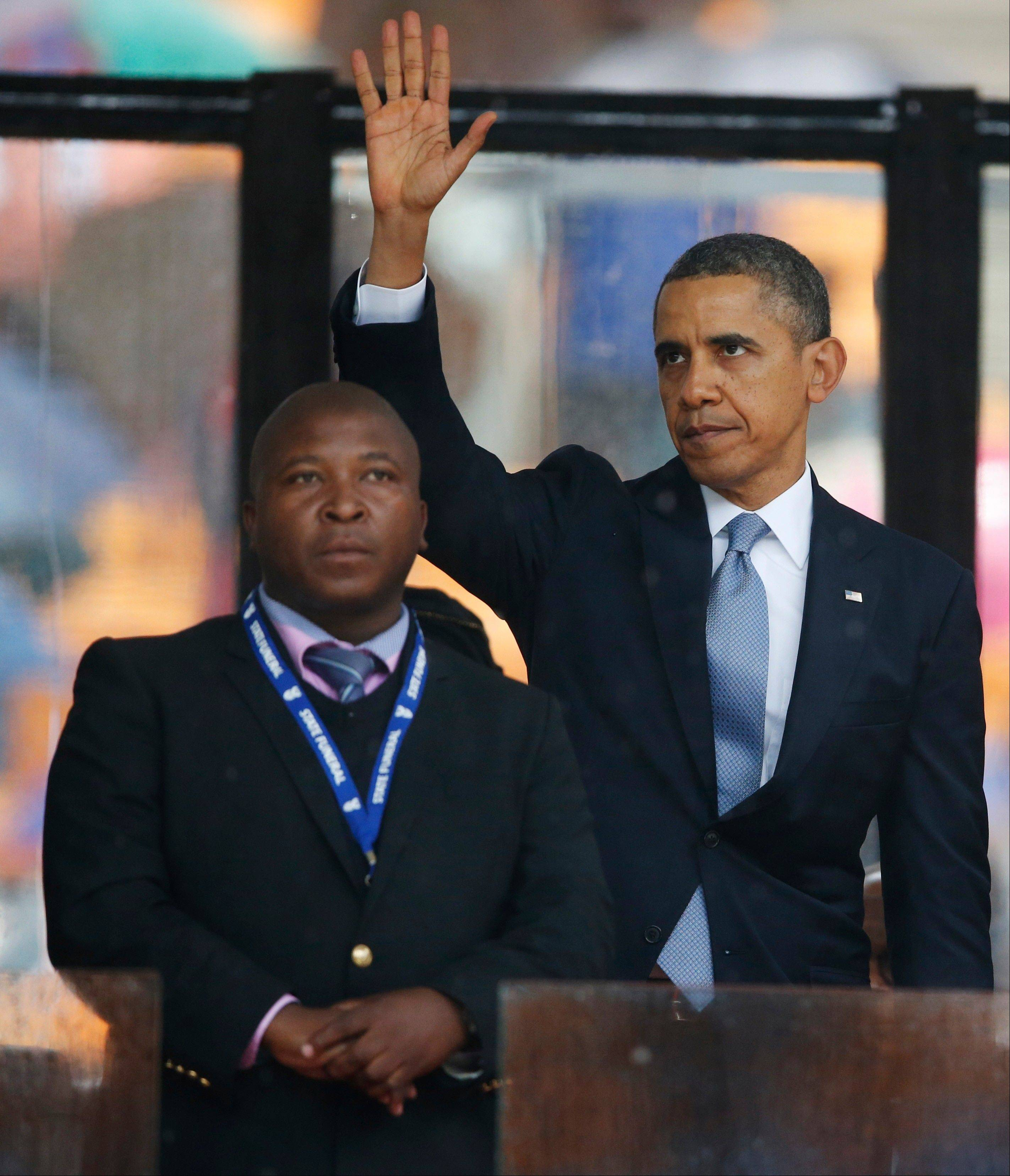 President Barack Obama stands next to the sign language interpreter after making his speech at the memorial service for former South African president Nelson Mandela on Tuesday. South Africa�s deaf federation said Wednesday the interpreter on stage for Mandela memorial was a �fake.�