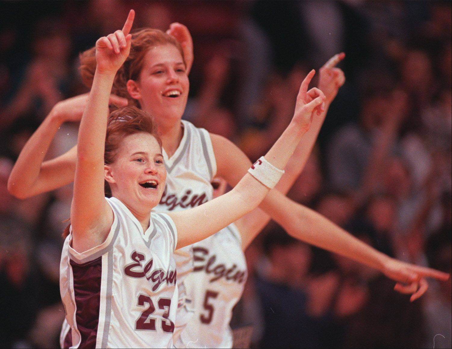 Elgin High graduates Melissa Parker, front, and Leslie Schock celebrate the Maroons' state semifinal win over Morris at the 1996 Class AA state tournament at Redbird Arena.