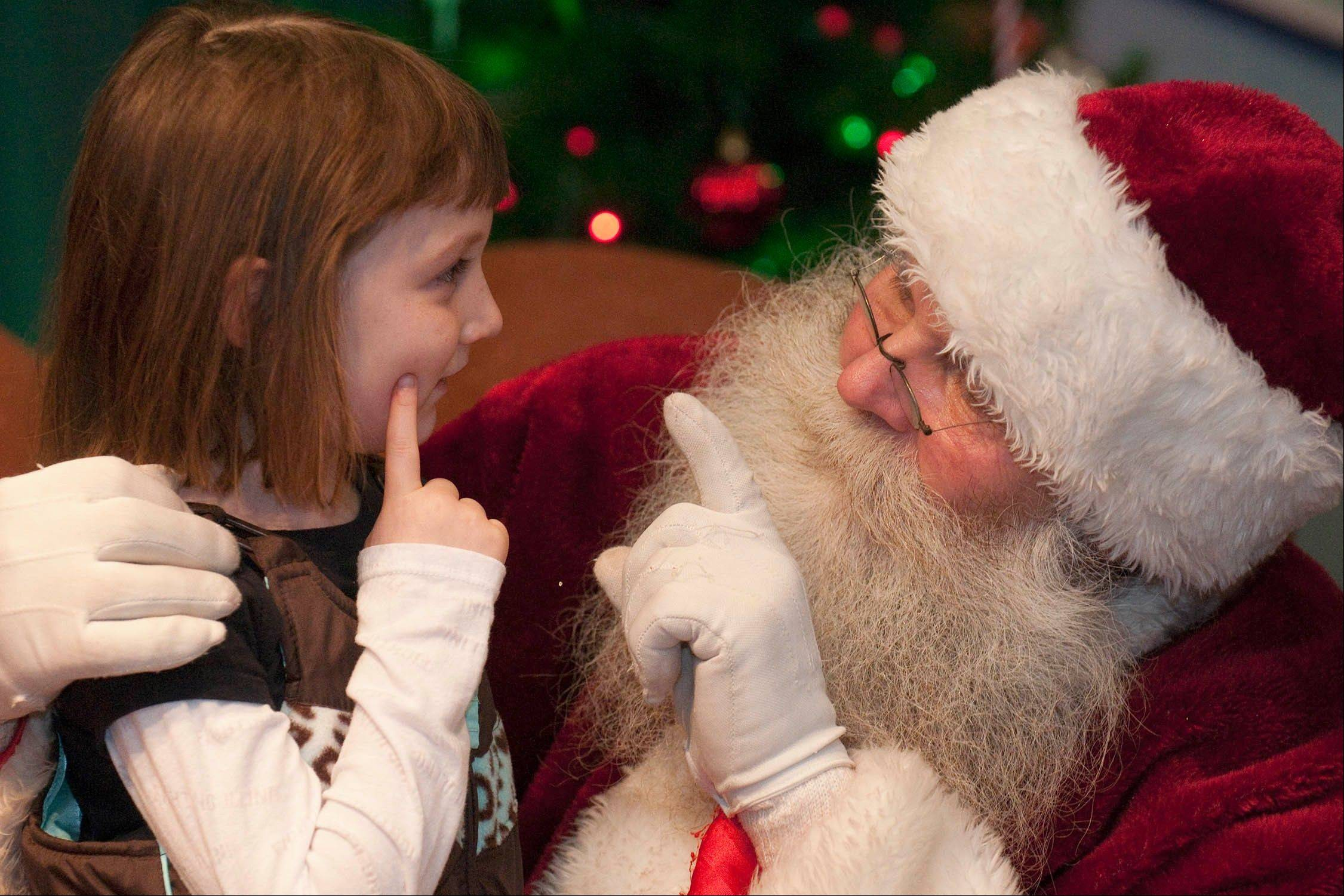 Courtesy of Scott Hardesty/ Chicago Zoological SocietyYoungsters can come face-to-face with Santa Claus himself at the annual Holiday Magic celebration at Brookfield Zoo.