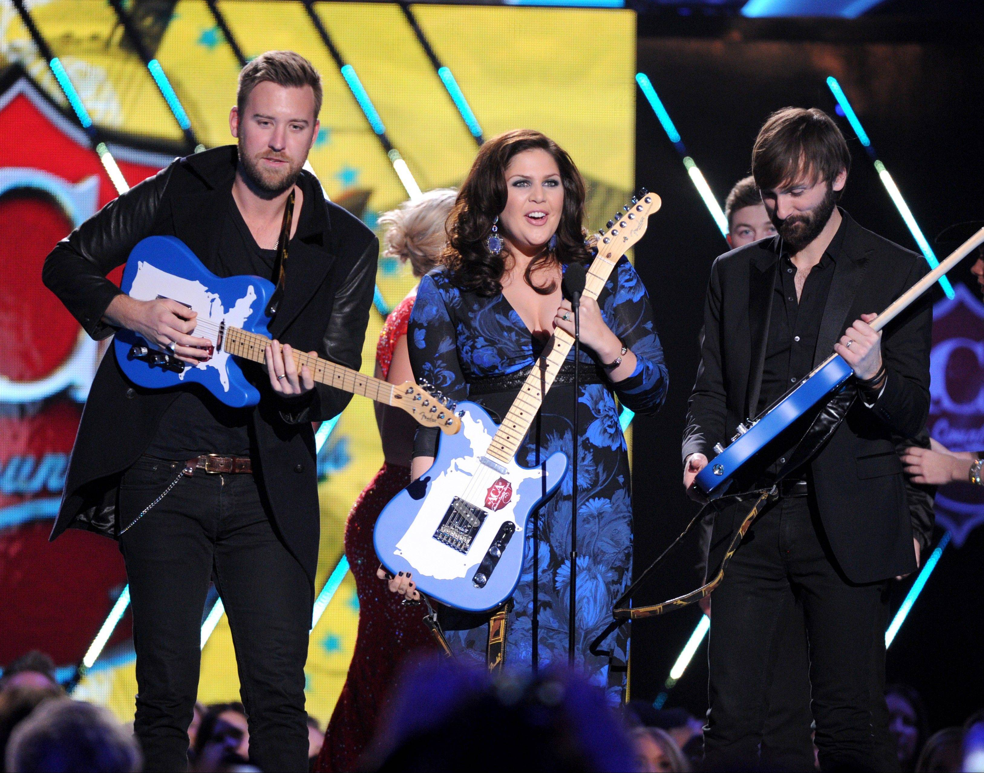 Charles Kelley, left, Hillary Scott and Dave Haywood of Lady Antebellum accept the group of the year award.