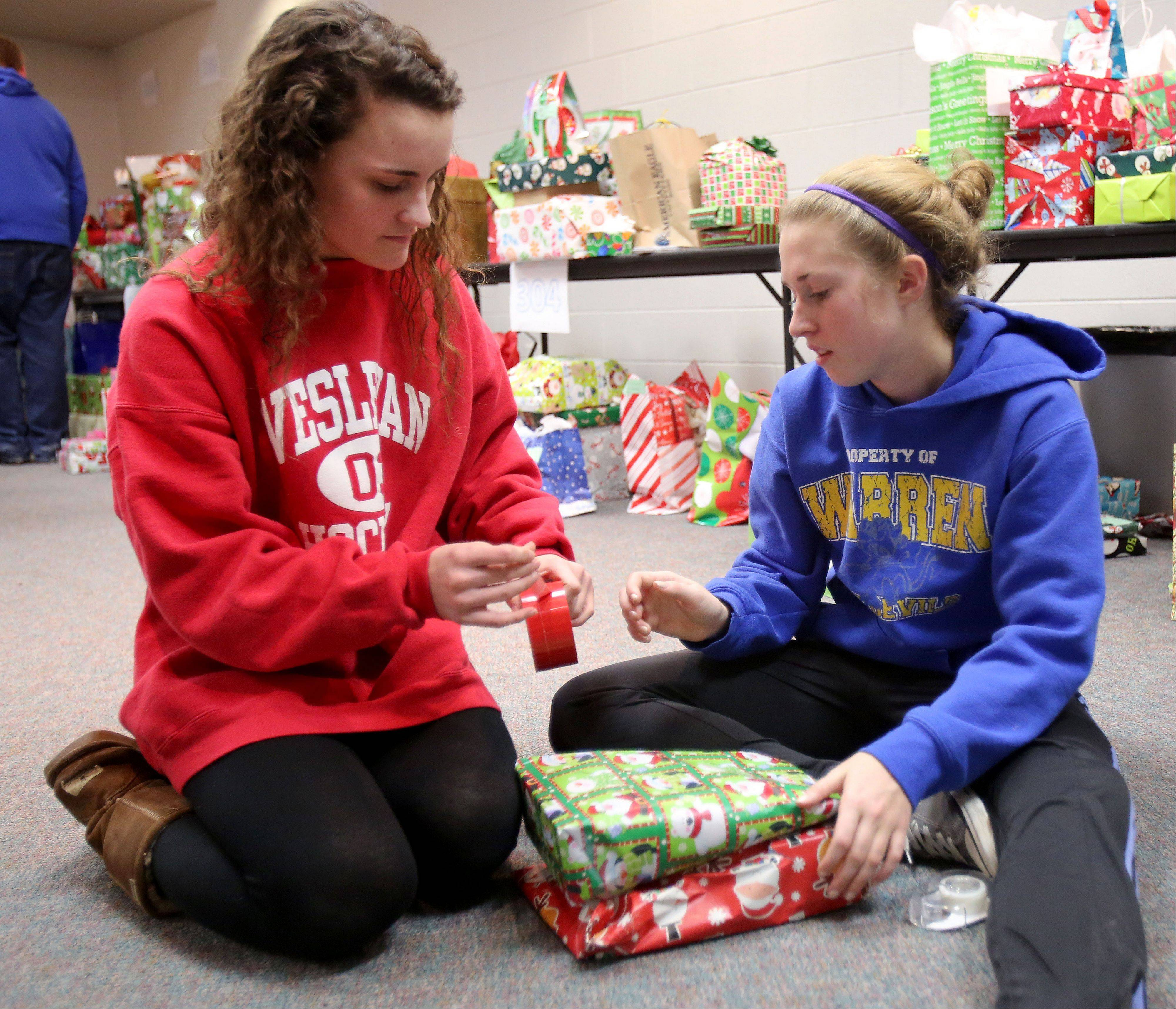 Warren Township High School seniors Jessica Rapp, left and Courtney Sunday wrap Christmas presents for their Letters for Santa Program. The presents will be delivered to the Reilly School in Chicago. Warren's Almond Road and O'Plaine Road campuses each provided about 700 donated gifts with a price limit of $25.