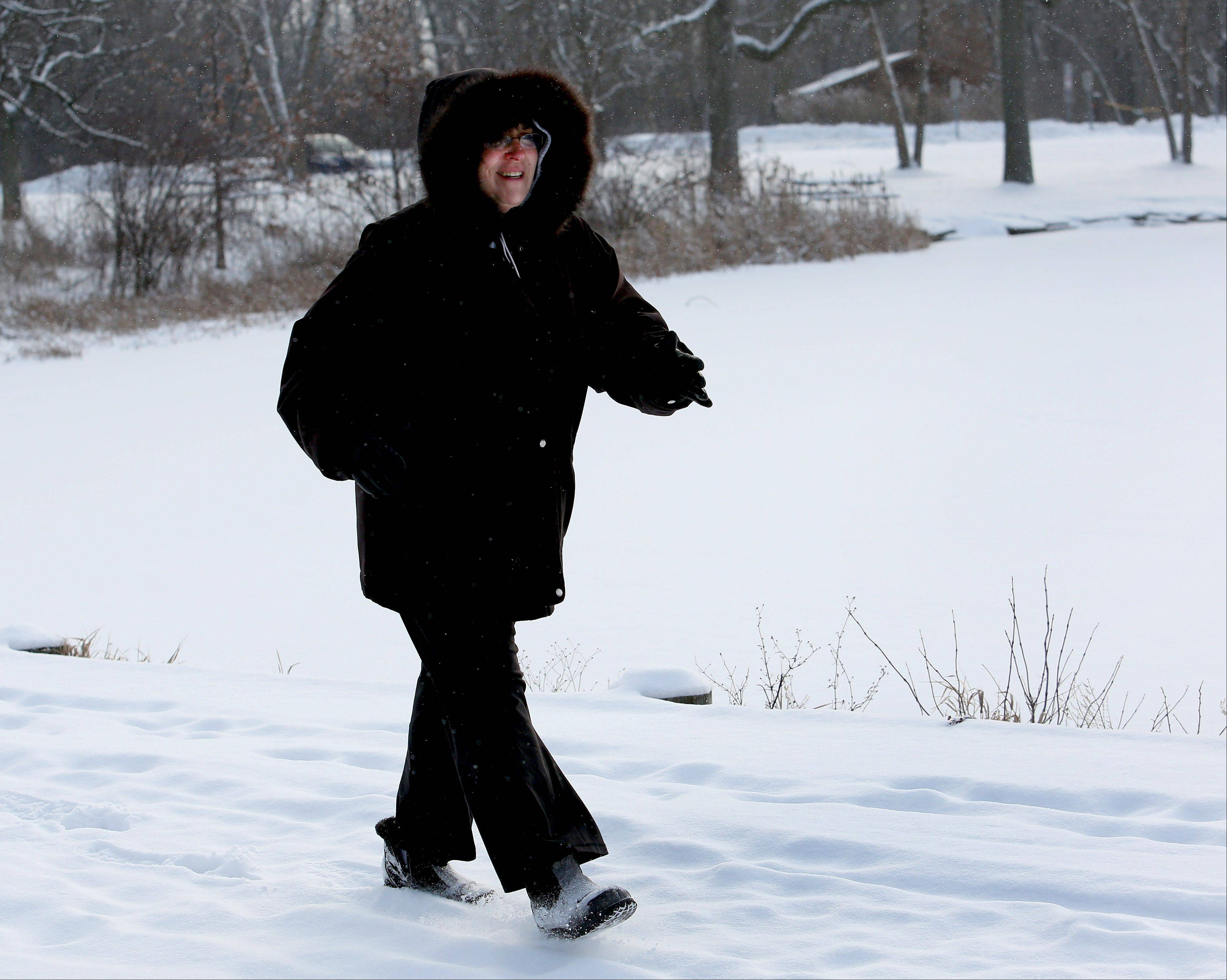 Gina Kraman of Wheaton enjoys a walk Wednesday morning in Herrick Lake Forest Preserve in Wheaton.