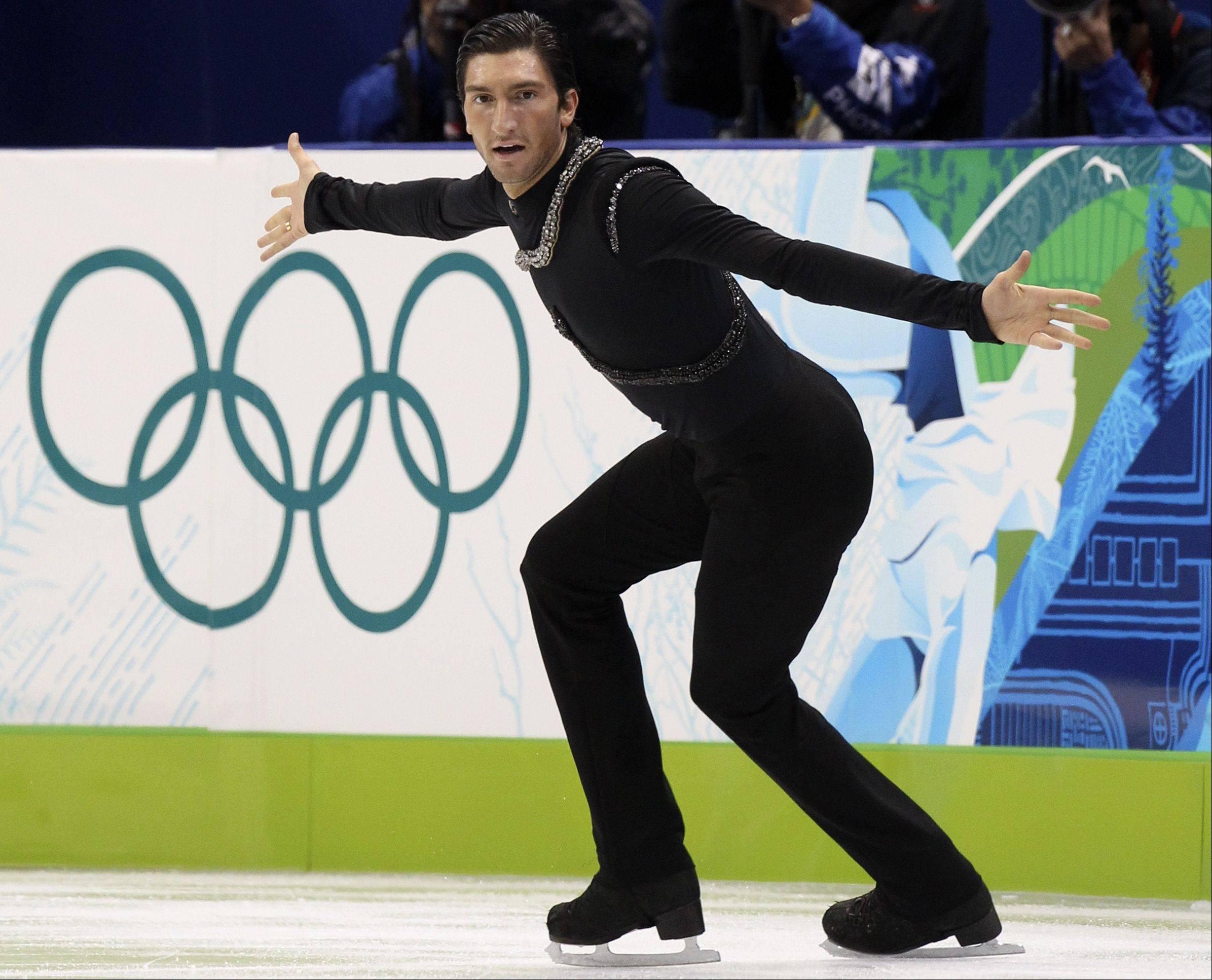 Naperville native Evan Lysacek will not be competing in the 2014 Olympics because of an injury to his left hip, he announced Tuesday. He is pictured here on his way to a gold medal in Vancouver in 2010.