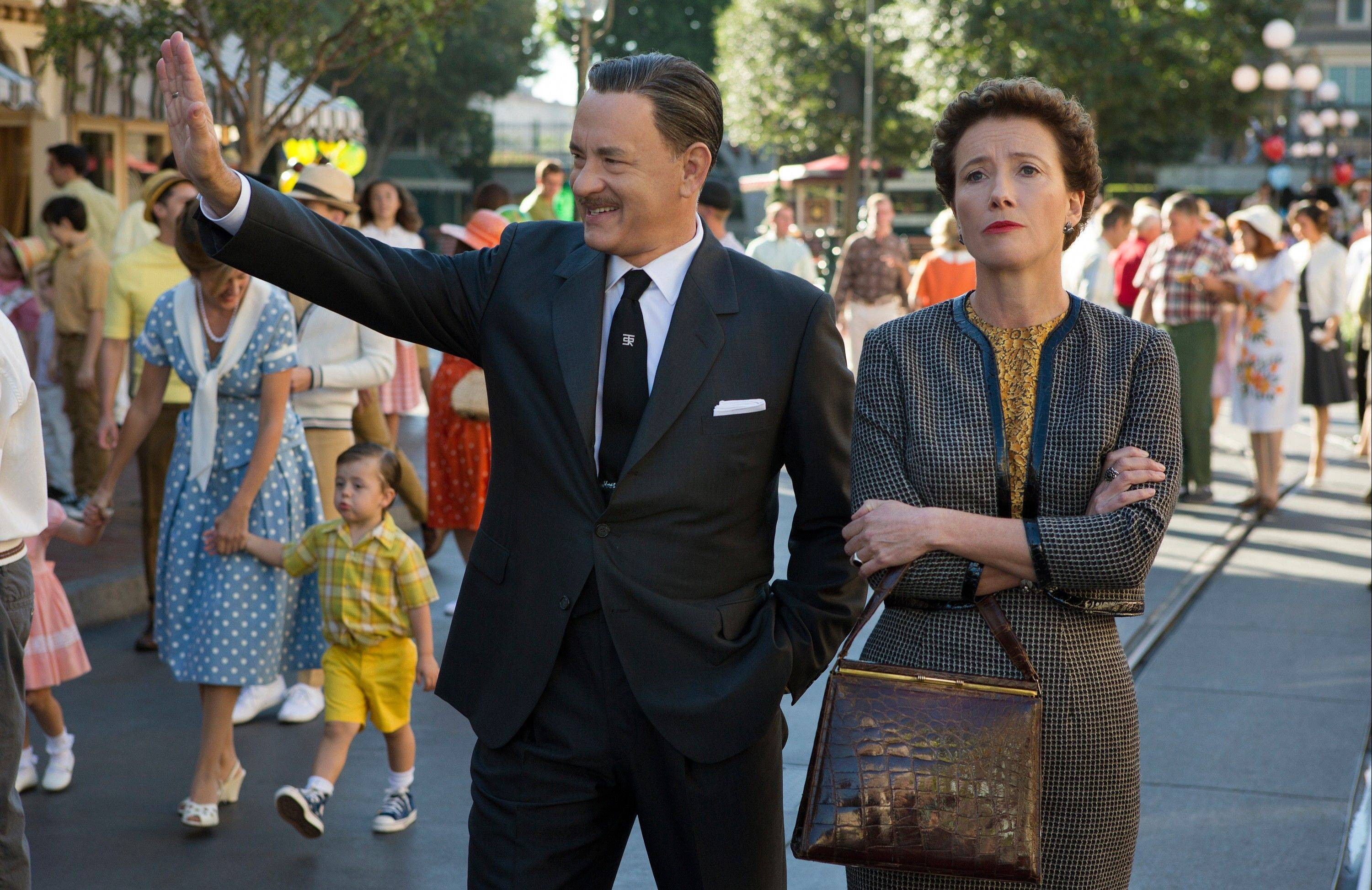 "Walt Disney (Tom Hanks) treats ""Mary Poppins"" novelist P.L. Travers (Emma Thompson) to a day at Disneyland in ""Saving Mr. Banks."""