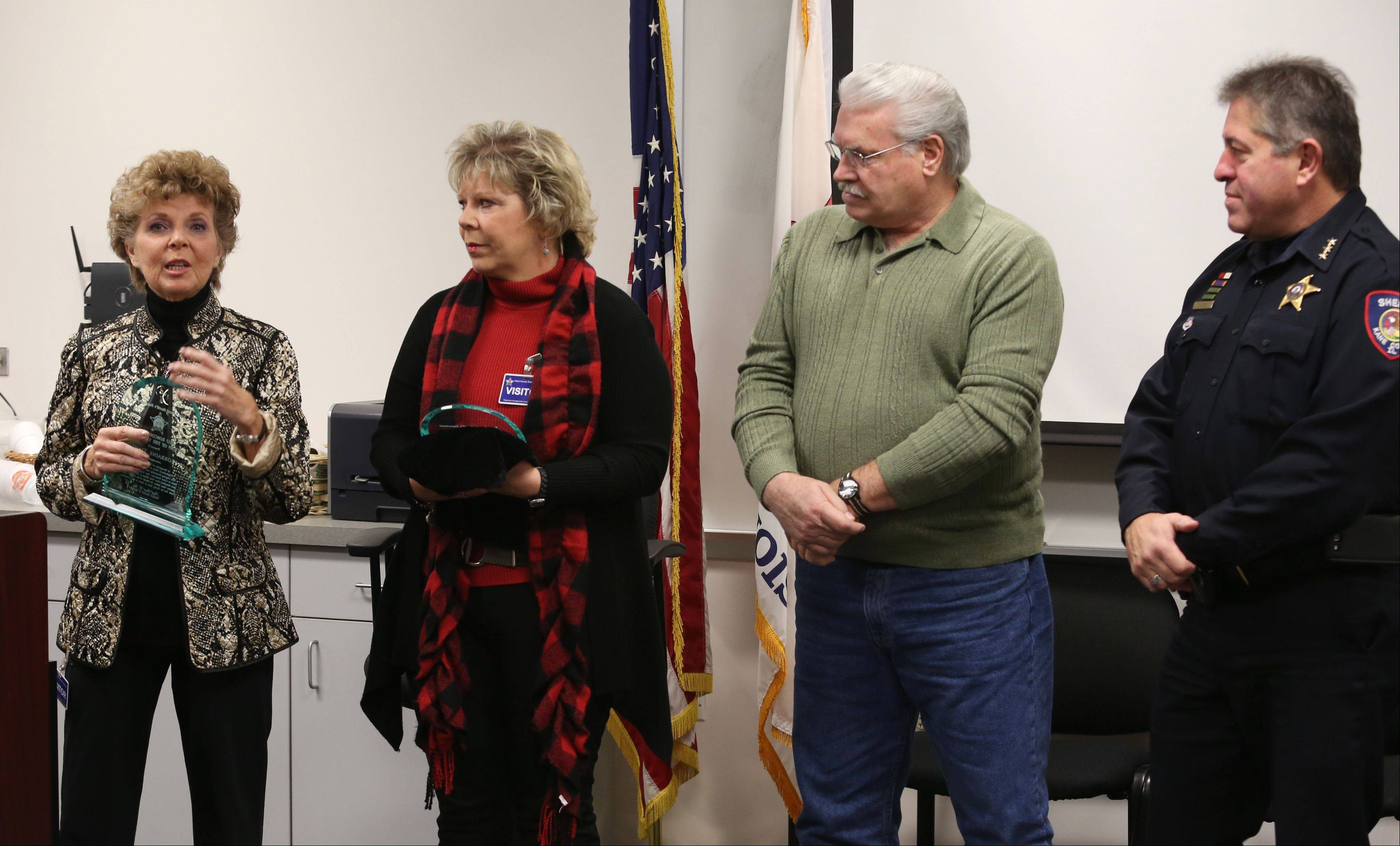 Roscoe Ebey Citizen of the Year co-recipients Lorraine Stahl, far left, and Christine Propheter are flanked by Richard Ebey, son of the award�s namesake, and Kane County Sheriff Pat Perez during a ceremony Thursday in St. Charles. Lea Minalga of St. Charles also shared in the award.