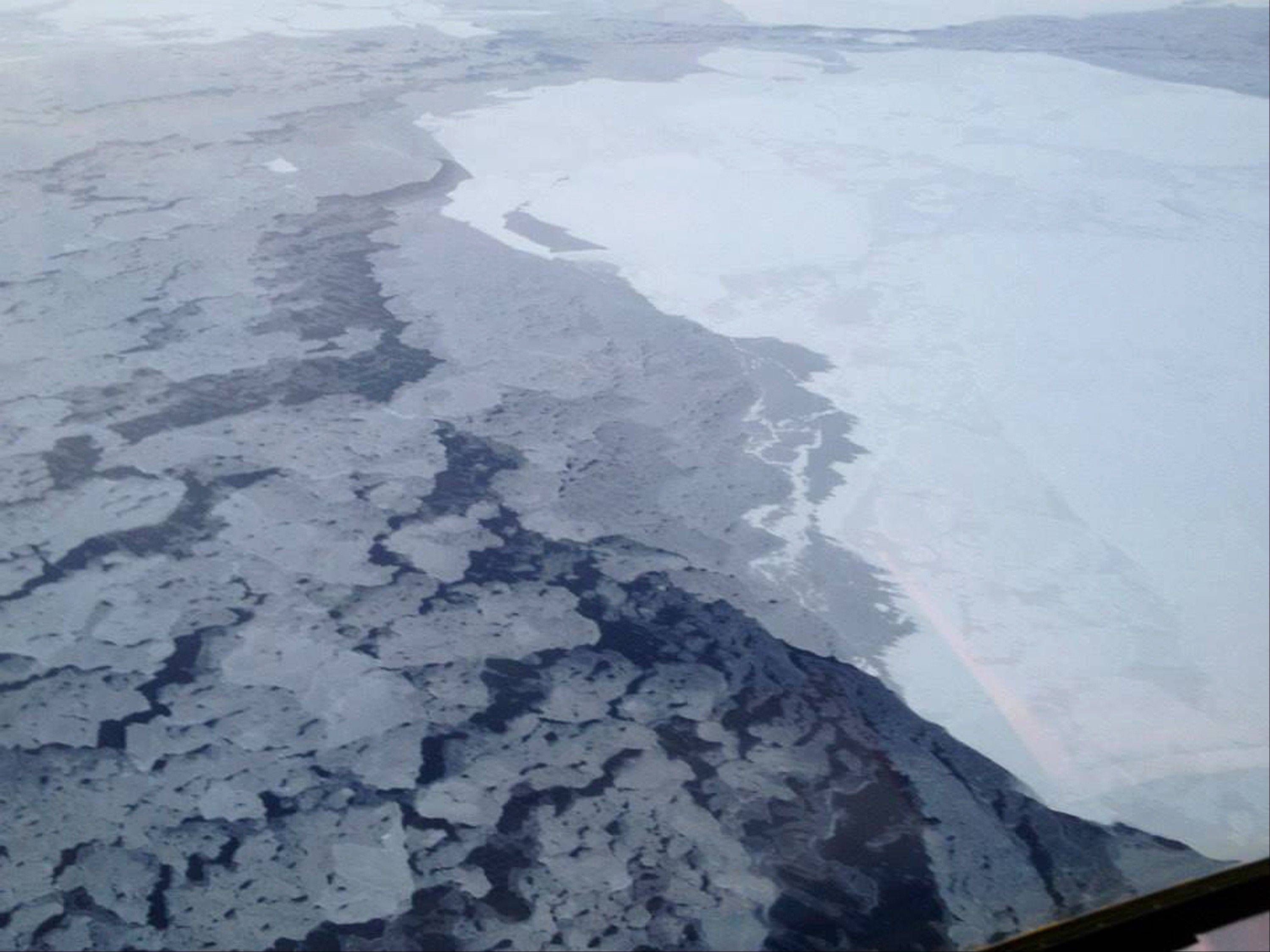 This handout photo provided by The National Oceanic and Atmospheric Administration (NOAA) shows Arctic sea ice earlier this year. The Arctic took a bit of a break from its rapid melting this year. But a federal Arctic report card says global warming is still massively altering the top of the world.