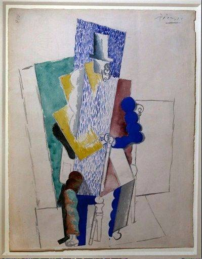 Picasso's 1914 cubist drawing L'homme au Gibus, Man with Opera Hat, is presented at Sotheby's auction house in Paris Thursday Dec. .