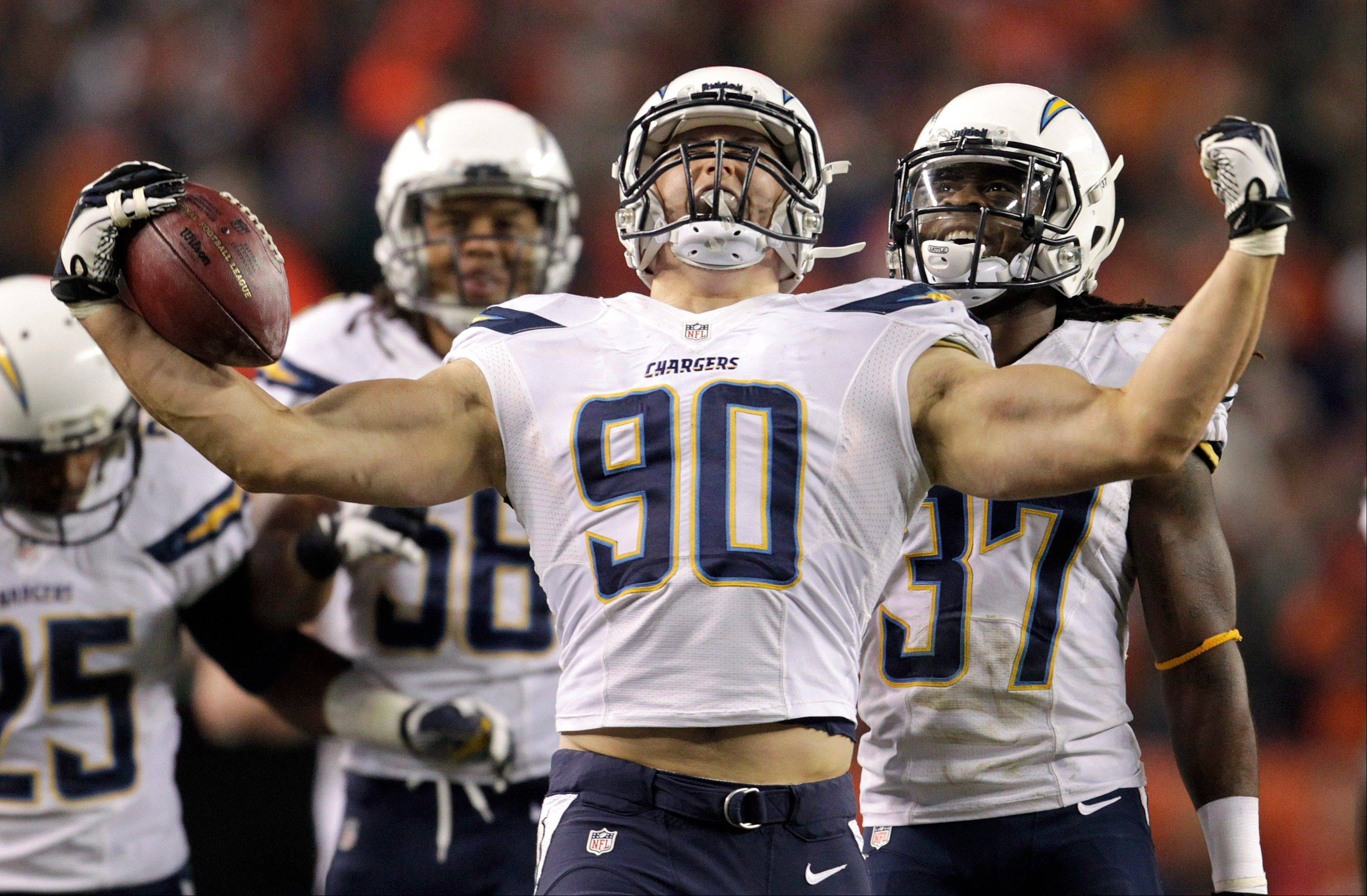 San Diego Chargers linebacker Thomas Keiser (90) reacts after intercepting a pass by Denver Broncos quarterback Peyton Manning (18) in the fourth quarter of an NFL football game, Thursday, Dec. 12, 2013, in Denver.