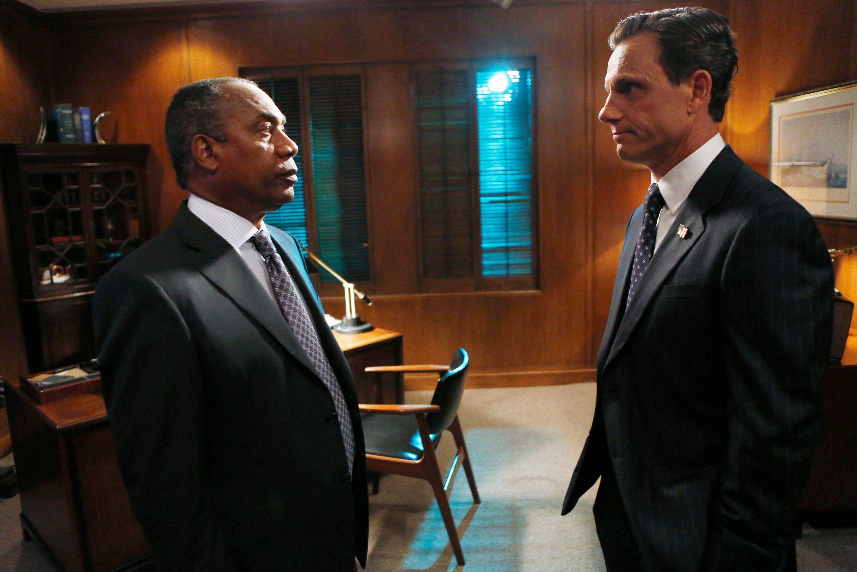 "What will become of Joe Morton, left, and Tony Goldwyn on ABC's ""Scandal""? Find out tonight."