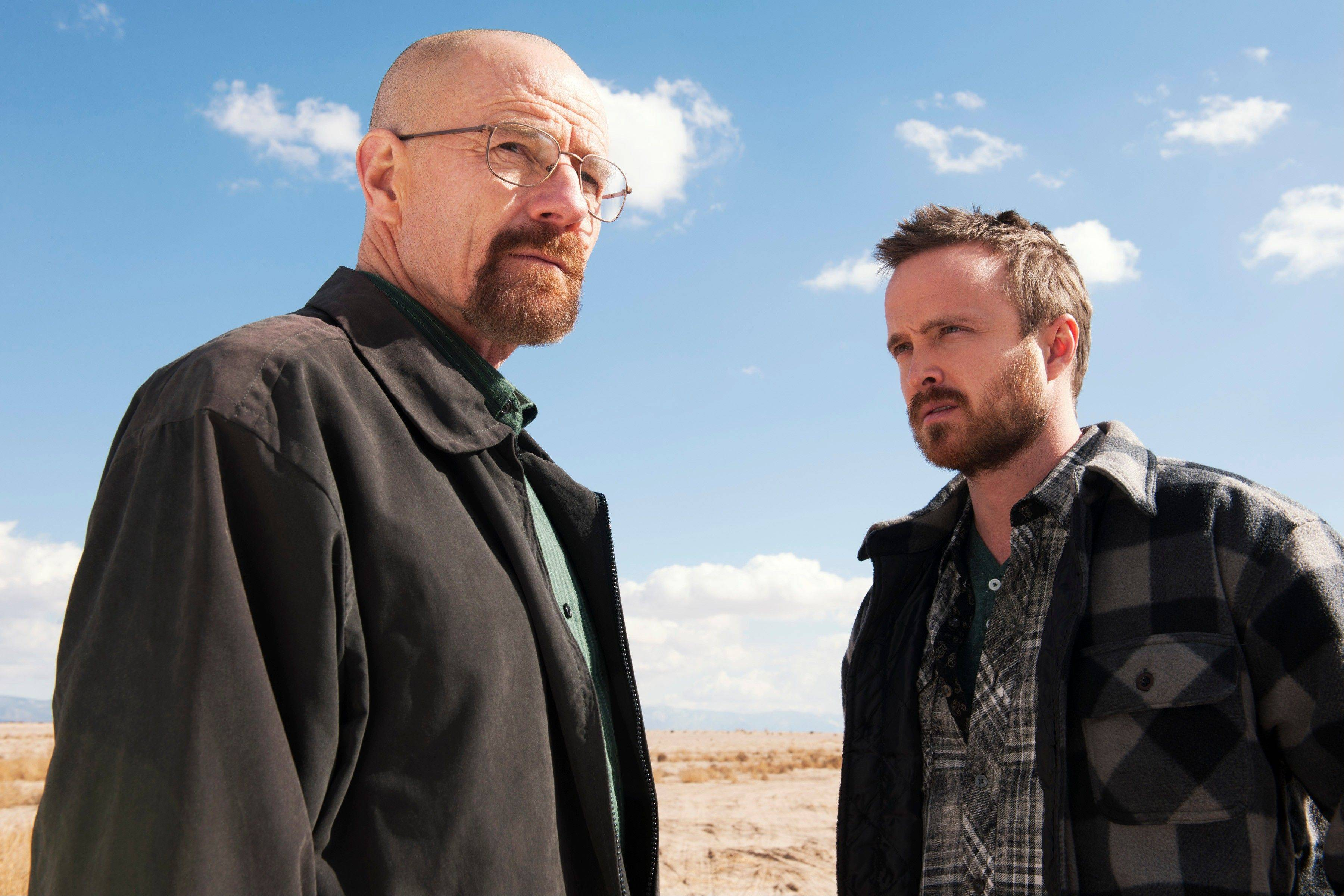 "Bryan Cranston, left, as Walter White is up for a best drama actor starred along with Aaron Paul as Jesse Pinkman in ""Breaking Bad,"" which was nominated for a Golden Globe for best drama series on Thursday. The 71st annual Golden Globes will air on Sunday, Jan. 12."