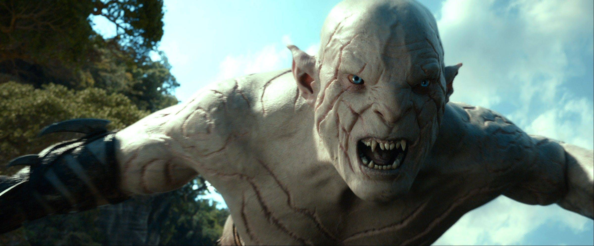 "Azog the Orc (Manu Bennett) menaces hobbits and dwarves in Peter Jackson's fifth J.R.R. Tolkien-based adventure ""The Hobbit: The Desolation of Smaug."""