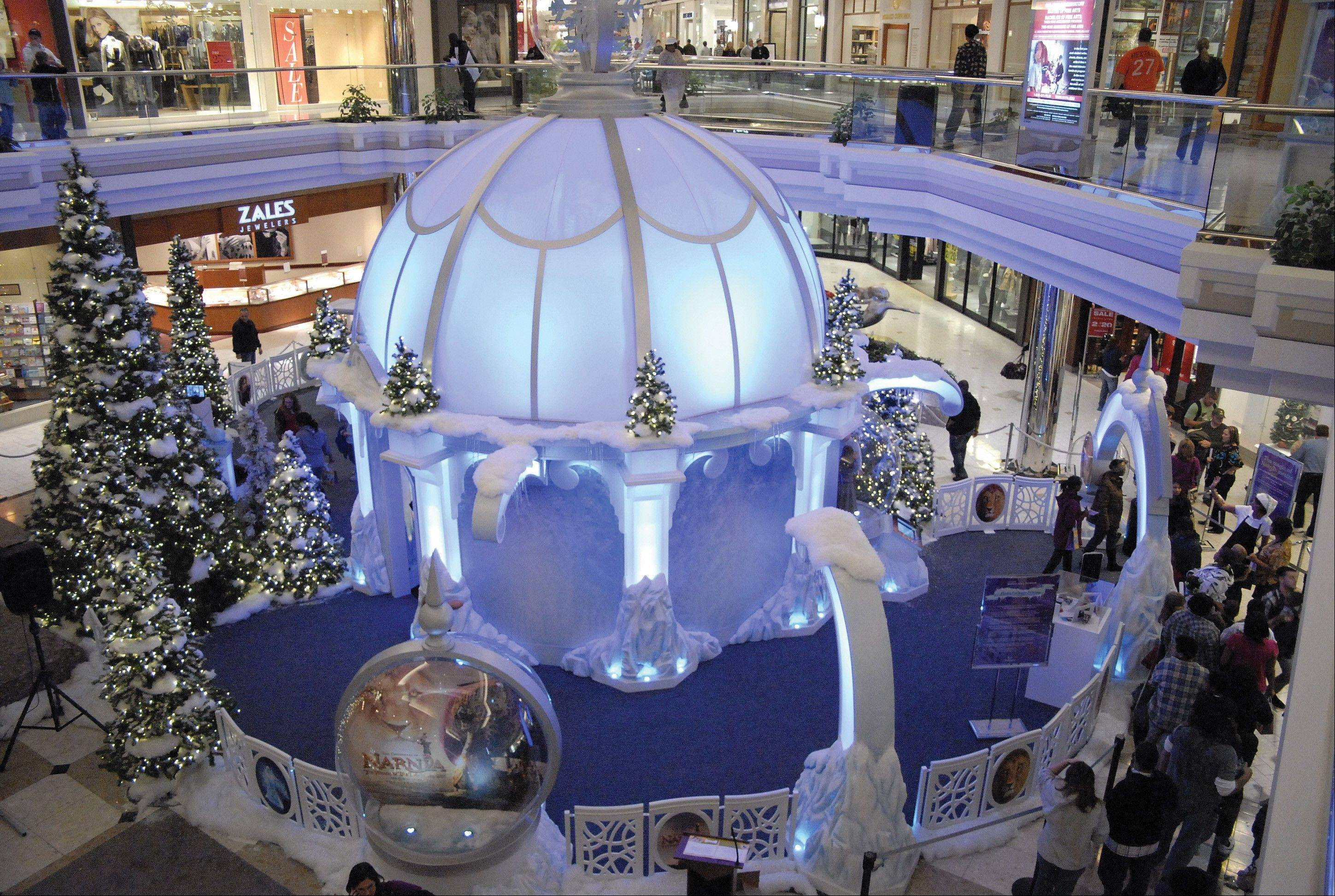 The Ice Palace, a 30-foot ice dome at MacArthur Center in Norfolk, Va., features falling snow, a light show, huge snow globes and a 360-degree interactive exhibit on the Arctic. The attraction is on display through Dec. 24.