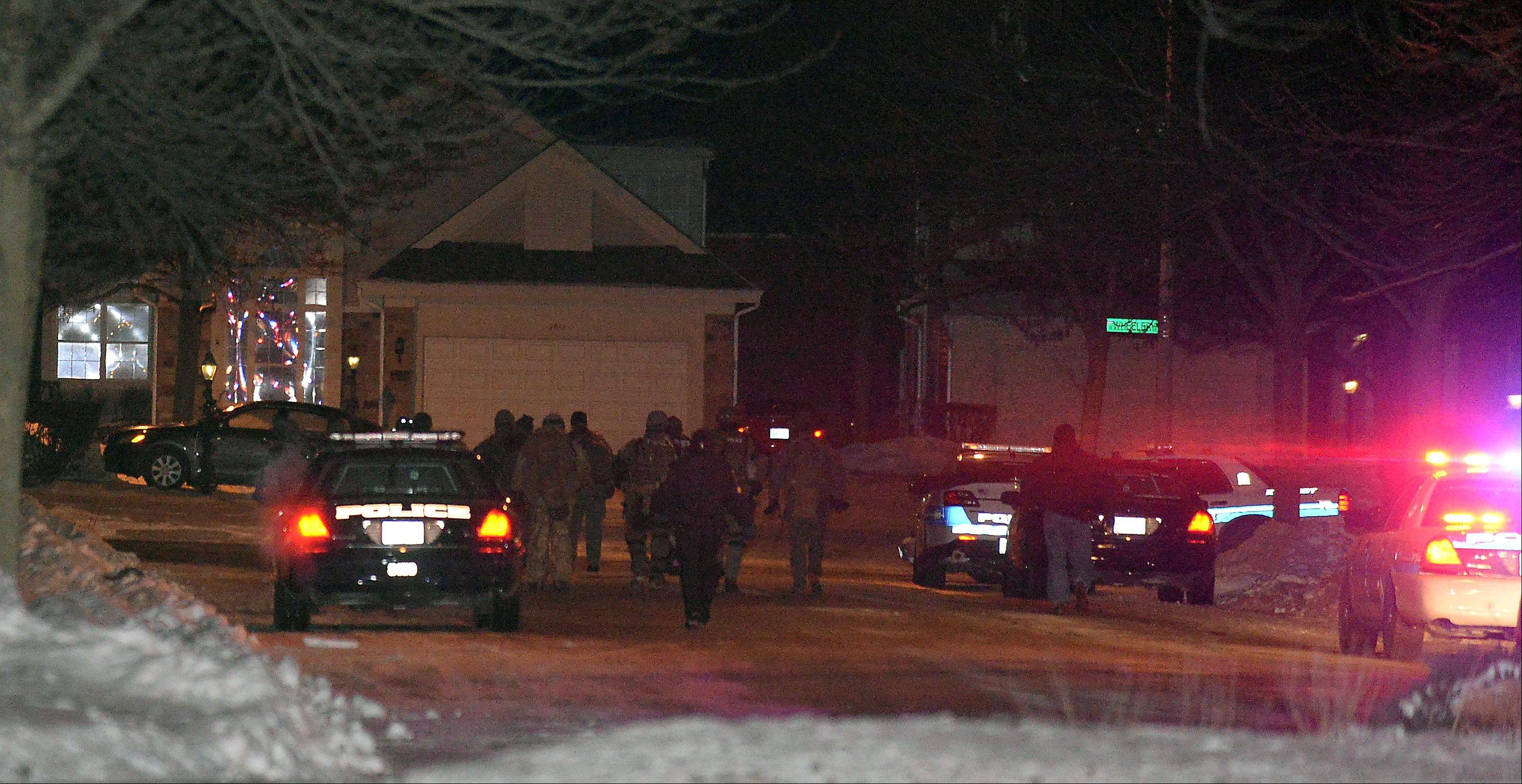 An Arlington Heights police officer was shot Thursday night after responding to a domestic incident. SWAT teams then responded to a hostage situation at the townhouse near Windham Court.$PHOTOCREDIT_ON$Mark Welsh/mwelsh@dailyherald.com$PHOTOCREDIT_OFF$