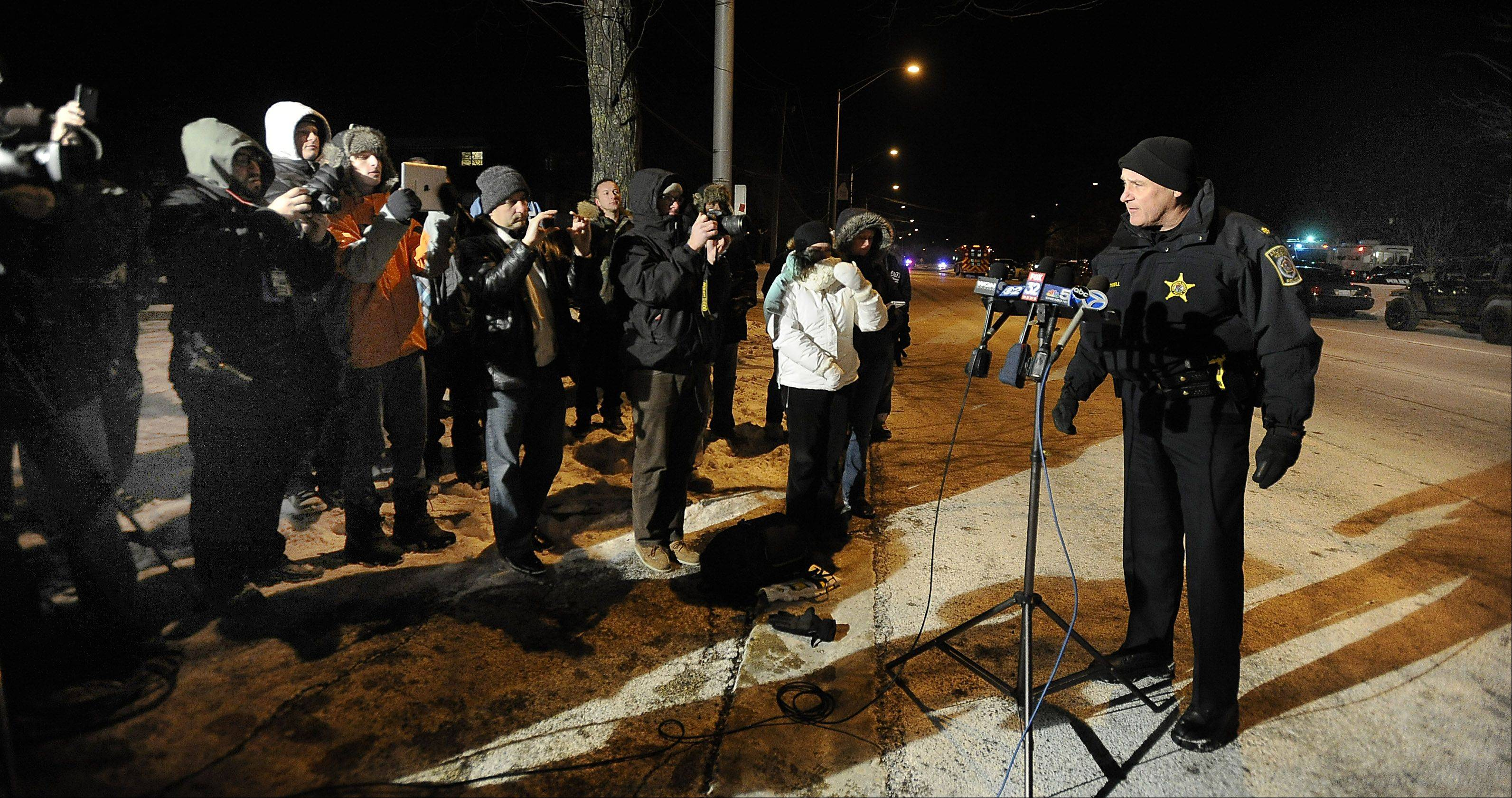 Arlington Heights Police Cmdr. Andrew Whowell addresses the media Thursday night after police resolved a hostage situation.