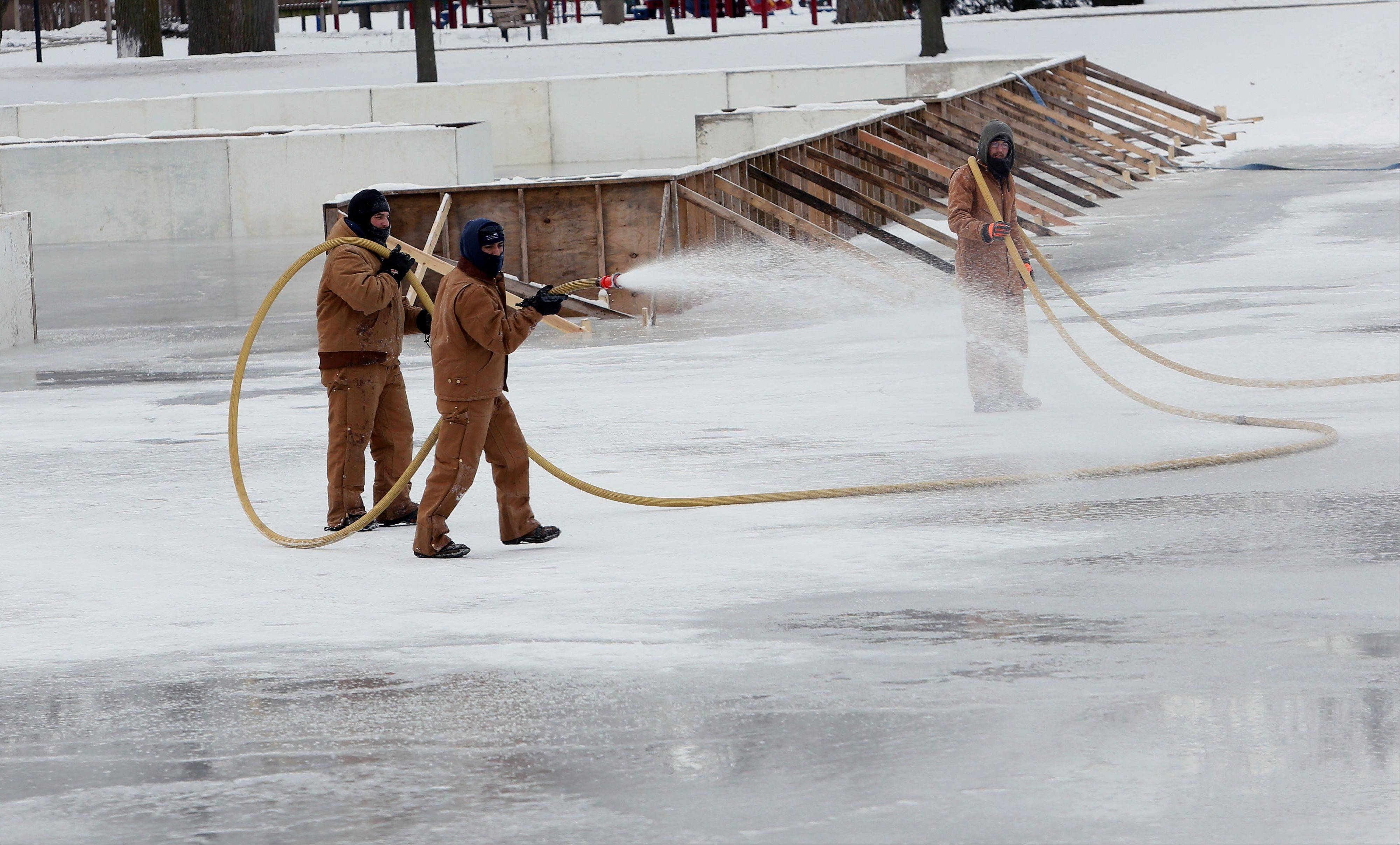 Naperville Park District crews add water Thursday to the Riverwalk ice rinks. Two other areas are now open for ice skating: Nike Sports Complex at 288 W. Diehl Road, and Gartner Park at 524 W. Gartner Road.