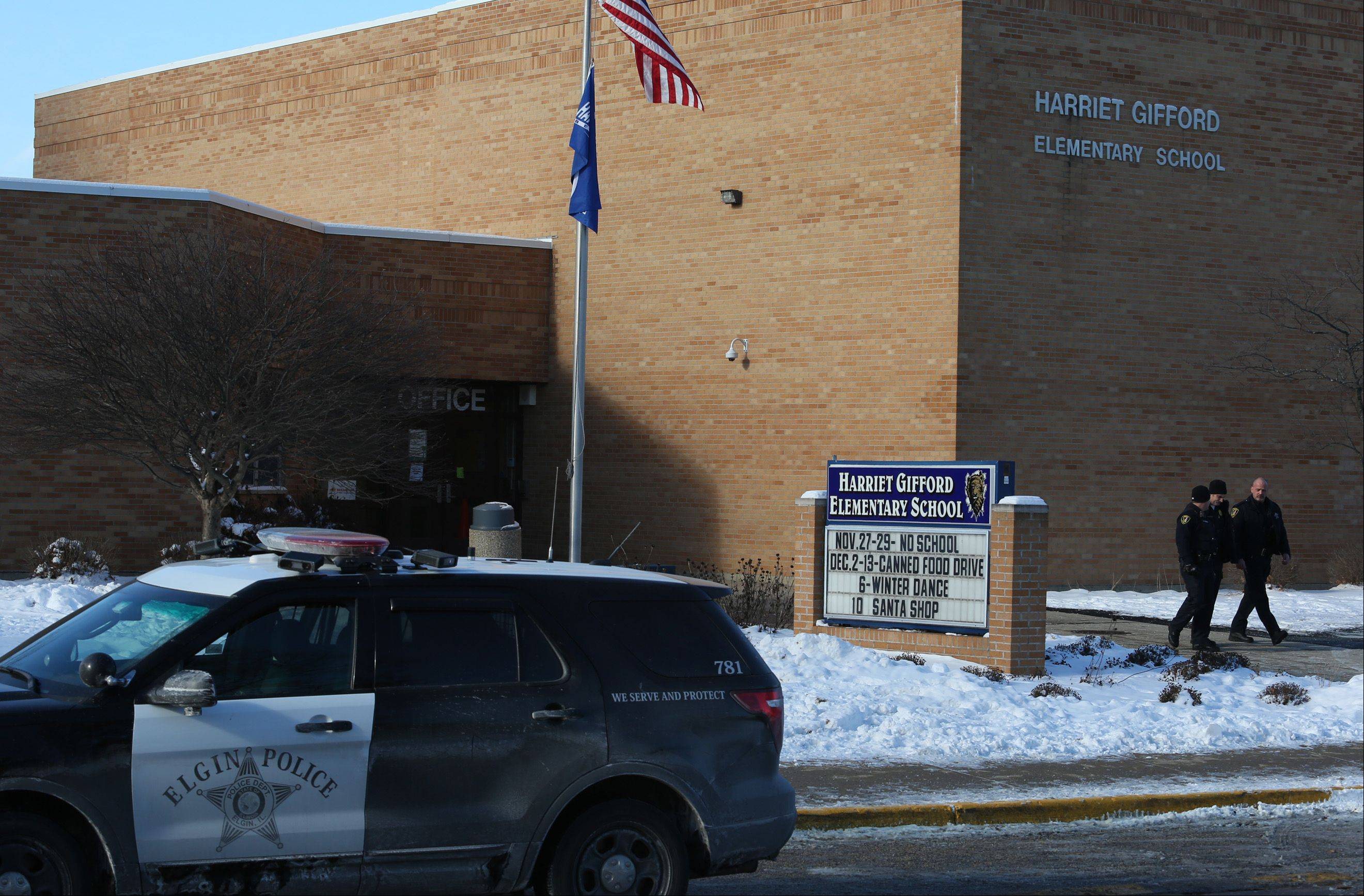 Elgin police leave Gifford Elementary School Thursday after investigating a student bringing a loaded handgun to school.