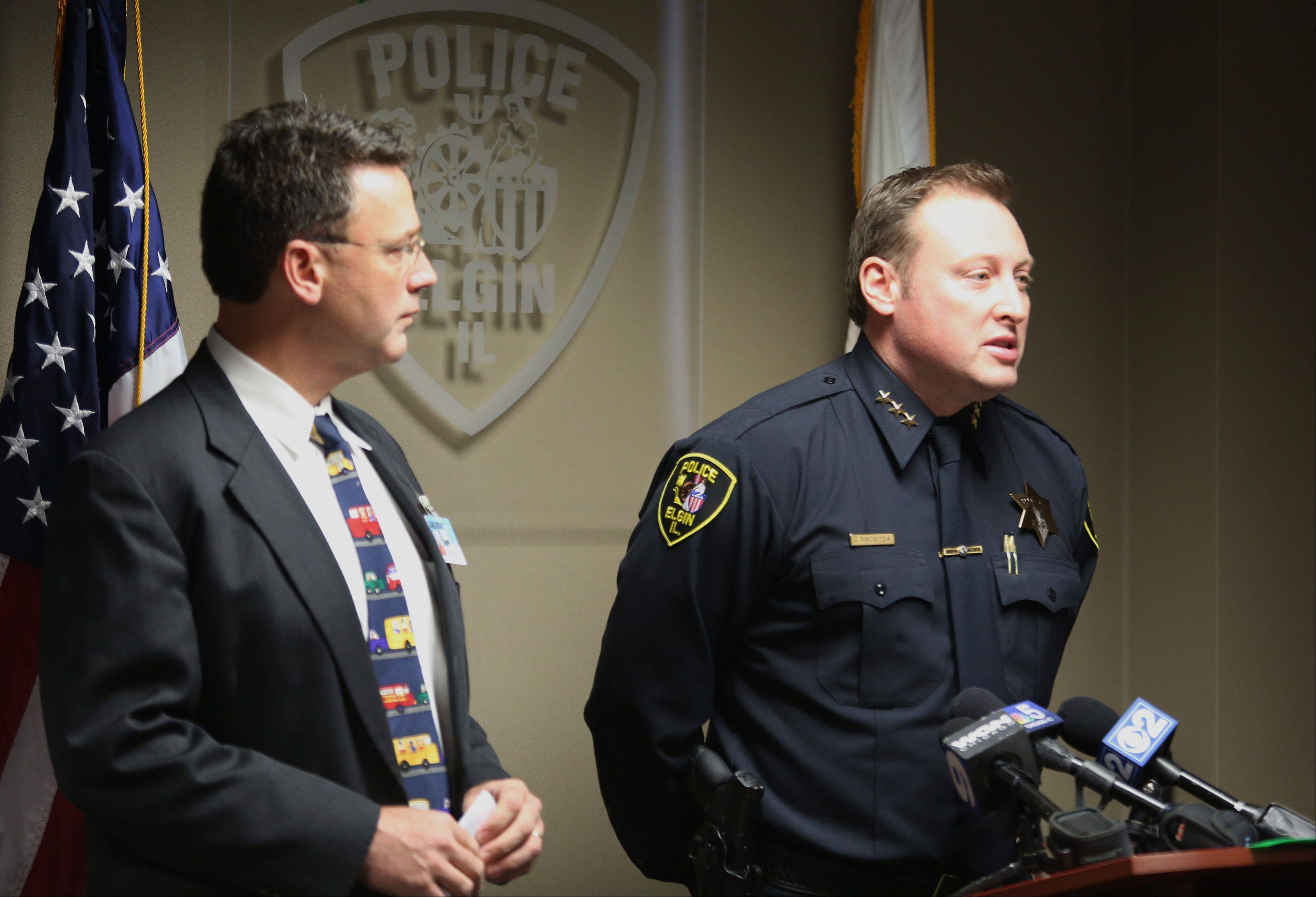 Elgin Police Chief Jeff Swoboda, right, speaks at a news conference Thursday afternoon regarding an incident at Gifford Elementary School after a student was found to have a loaded 9 mm handgun in his backpack. At left is Elgin Area School District U-46 Safety Coordinator John Heiderscheit.