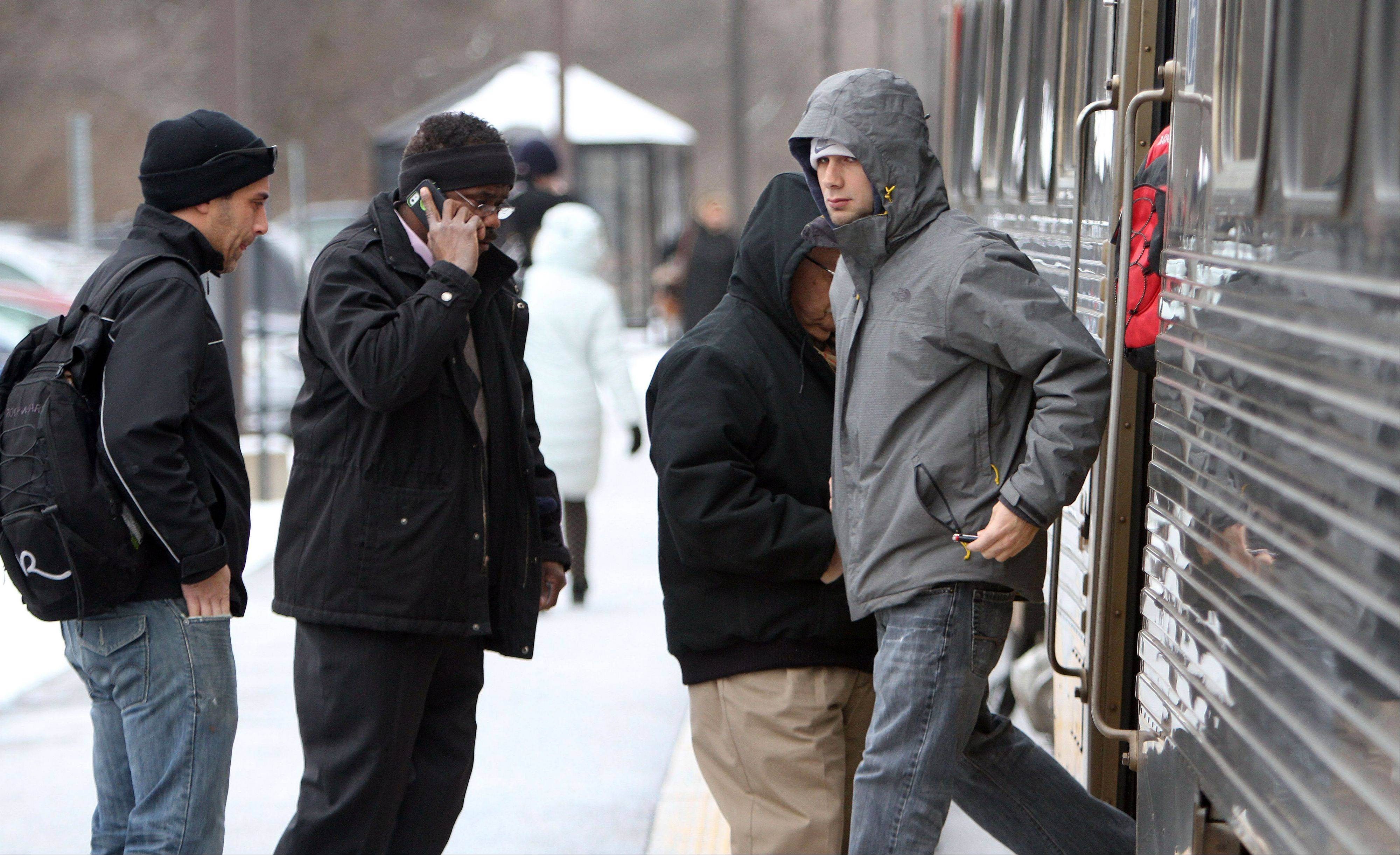 Metra commuters bundled up Thursday morning in Libertyville as temperatures dropped into the single digits.