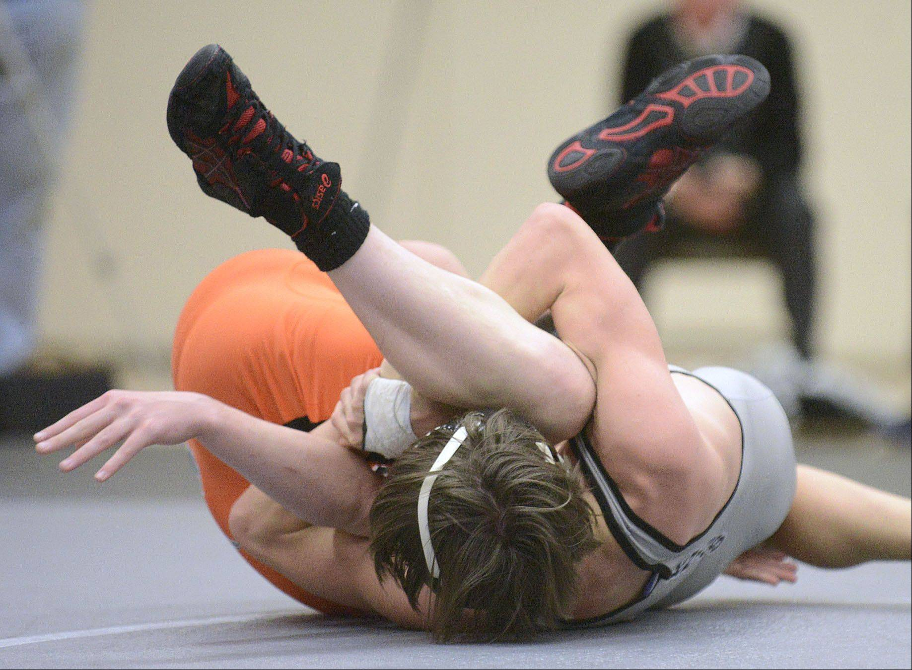 Kaneland's Nick Mish takes DeKalb's Alex Irick in the 106 pound match on Thursday, December 12.